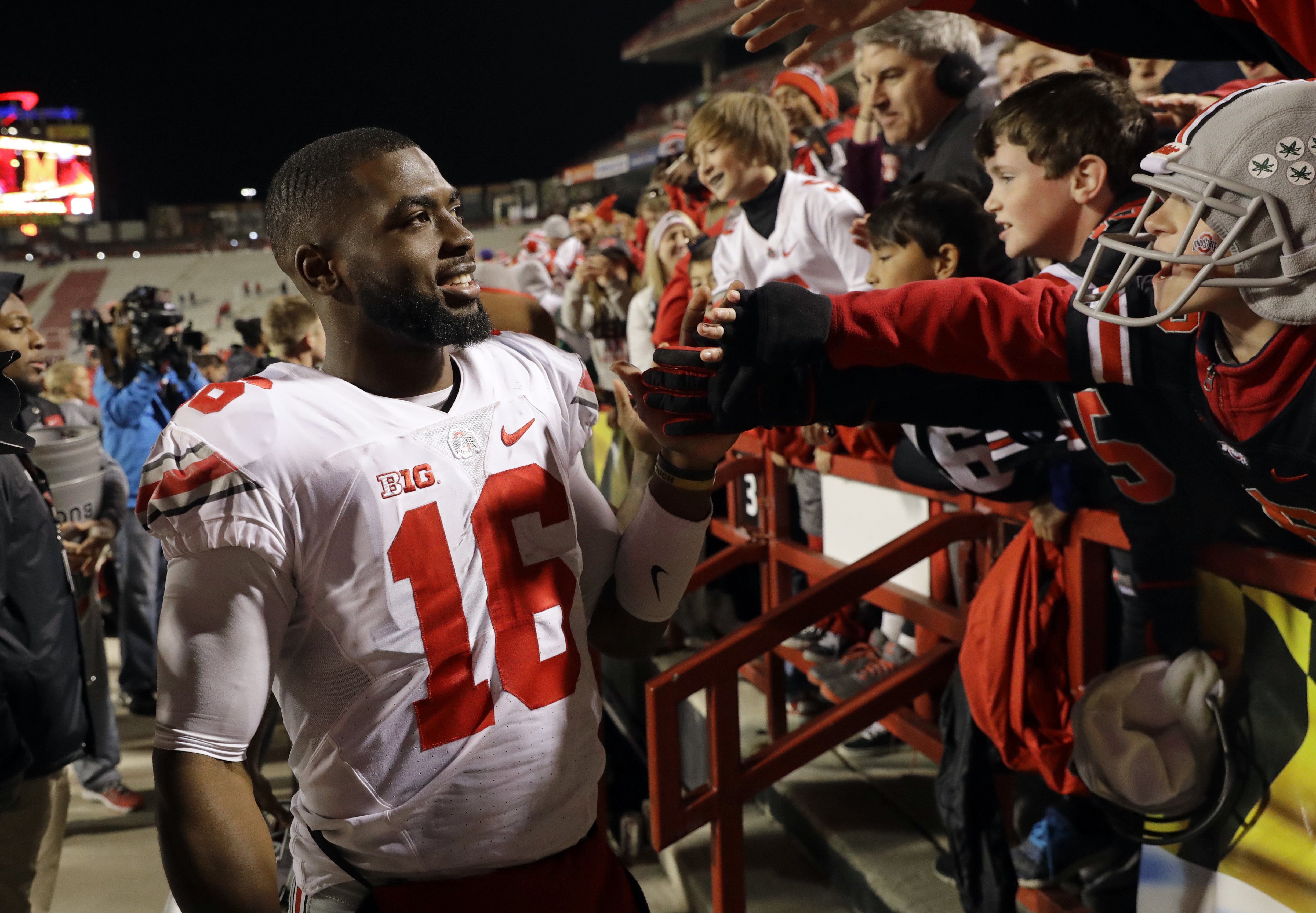 Ohio State quarterback J.T. Barrett greets fans after an NCAA college football game against Maryland in College Park, Md., Saturday, Nov. 12, 2016. (AP Photo/Patrick Semansky)