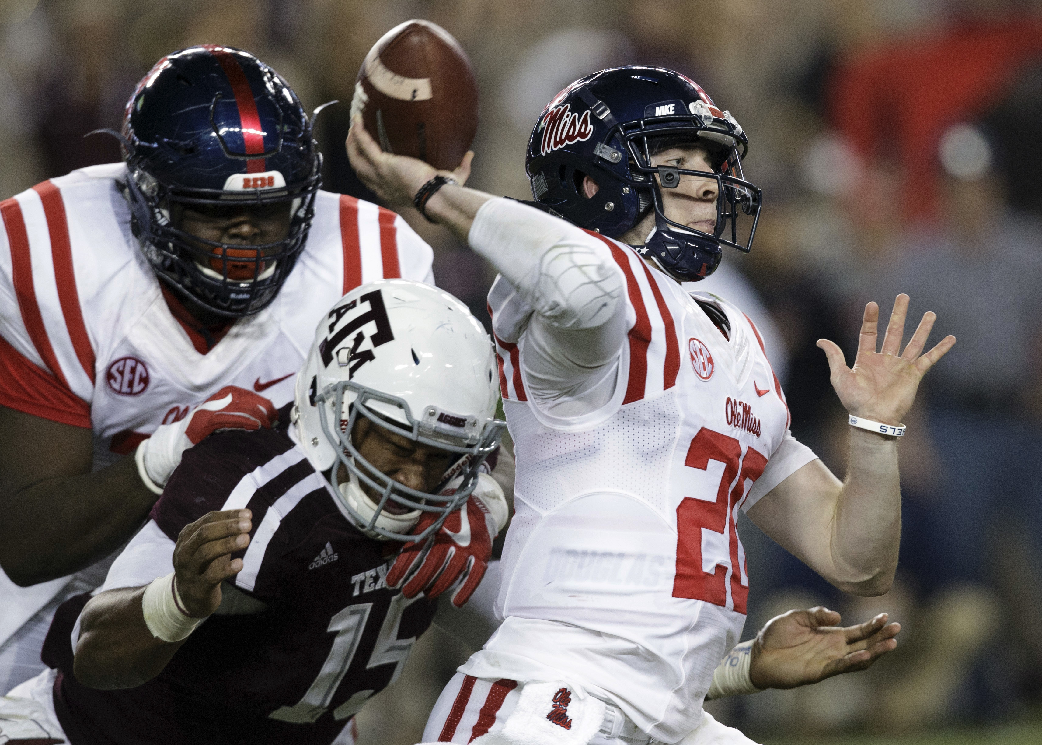 Texas A&M defensive lineman Myles Garrett (15) pressures Mississippi quarterback Shea Patterson (20) during the second quarter of an NCAA college football game Saturday, Nov. 12, 2016, in College Station, Texas. (AP Photo/Sam Craft)