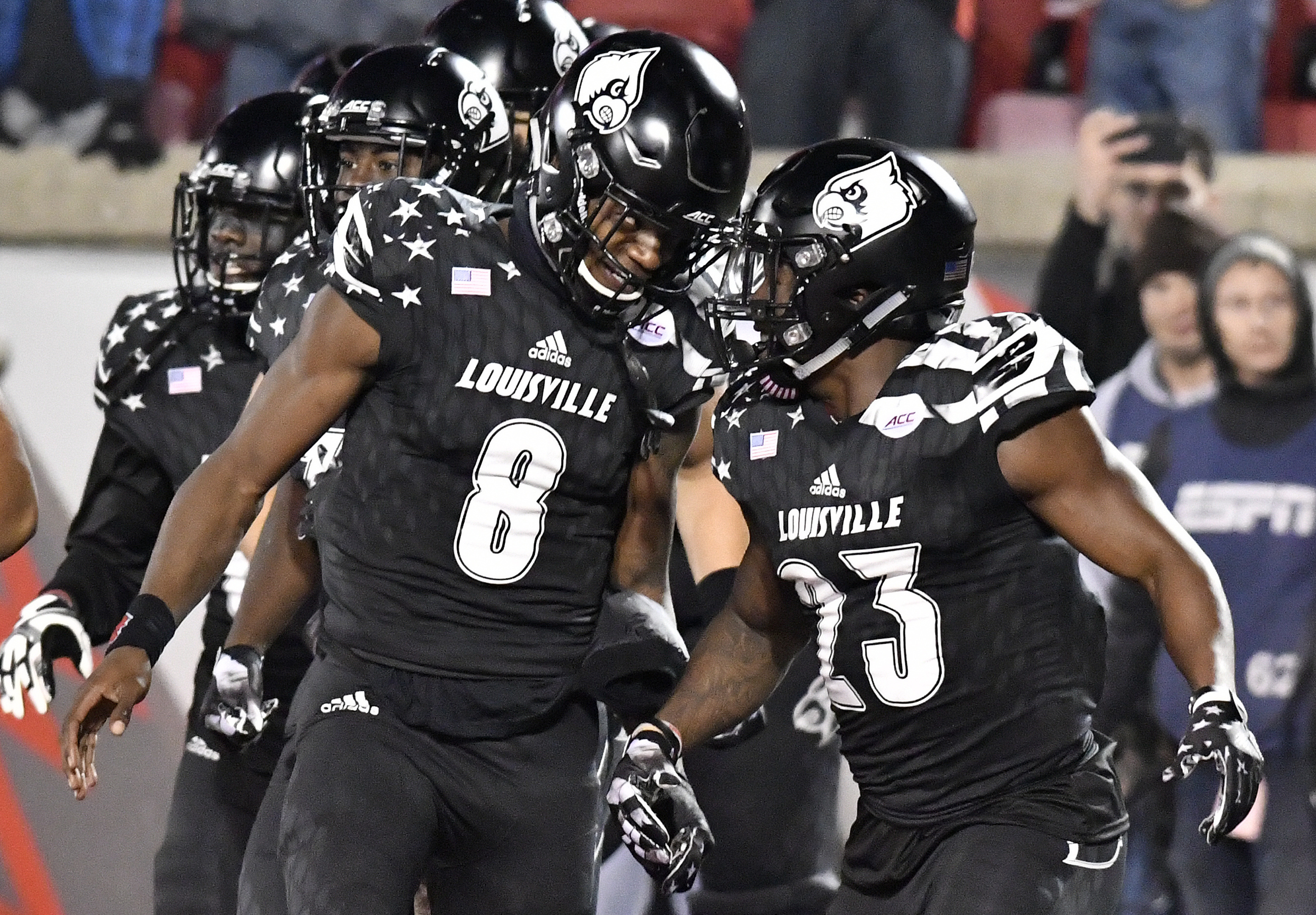 Louisville quarterback Lamar Jackson (8) and Brandon Radcliff (23) celebrate a touchdown during the second half of an NCAA college football game against Wake Forest, Saturday, Nov. 12, 2016, in Louisville, Ky. Louisville won 44-12. (AP Photo/Timothy D. Ea