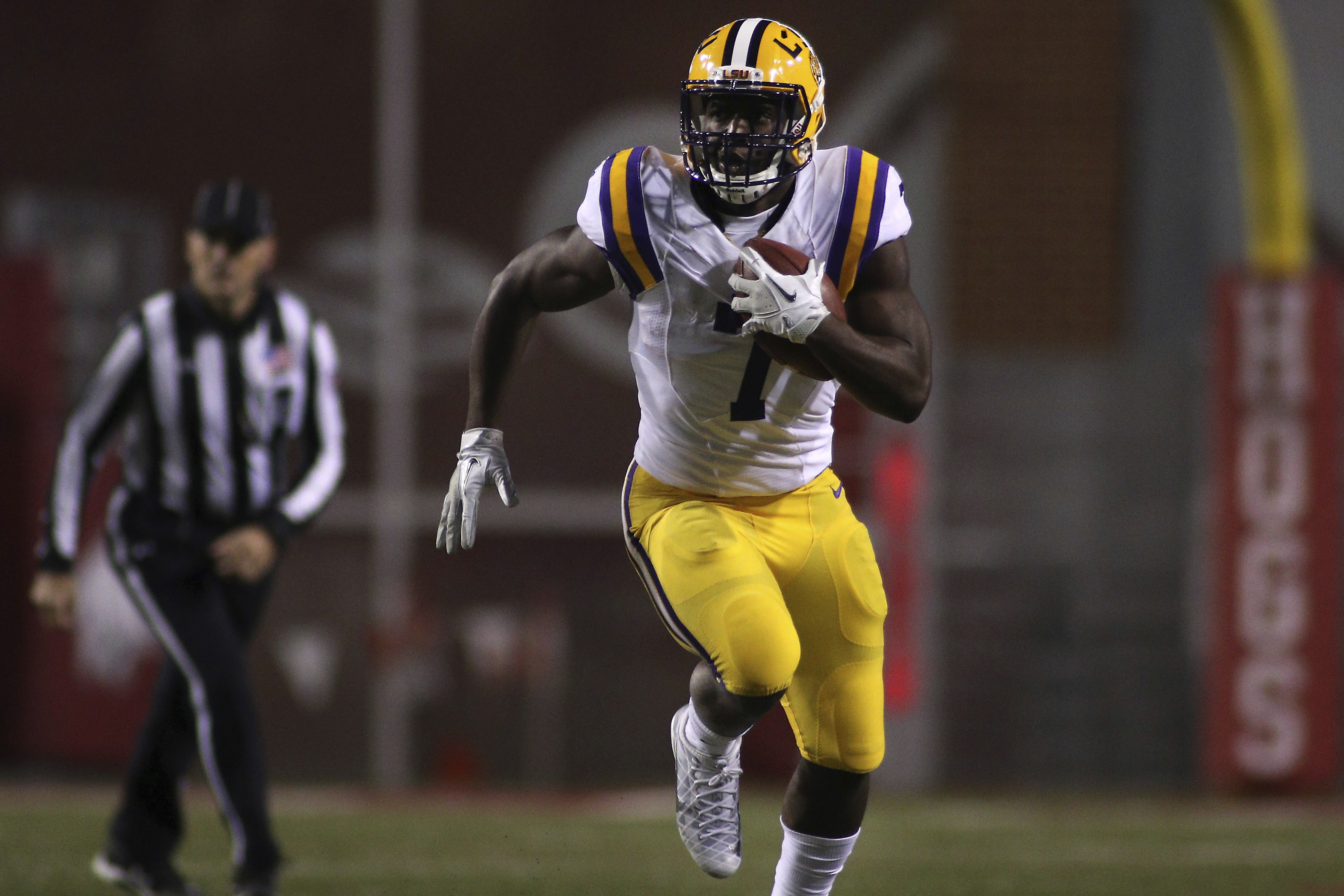 LSU's Leonard Fournette (7) rushes downfield during the first half of an NCAA college football game against Arkansas, Saturday, Nov. 12, 2016, in Fayetteville, Ark. (AP Photo/Samantha Baker)
