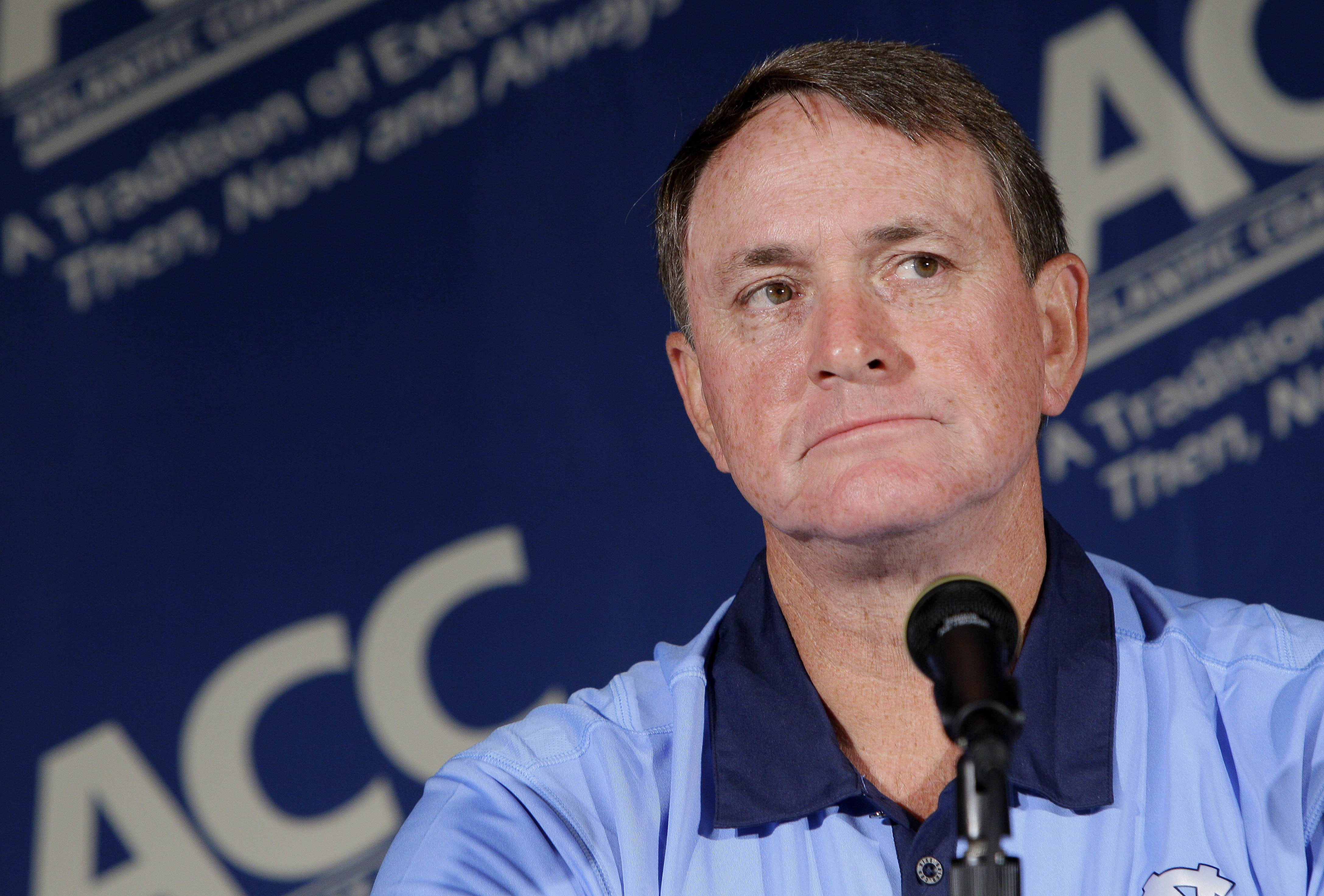 FILE - In this July 25, 2011 file photo, North Carolina coach Butch Davis pauses during interviews at the Atlantic Coast Conference Football Kickoff in Pinehurst, N.C. Davis was hired Monday, Nov. 14, 2016, as the new coach at FIU. (AP Photo/Gerry Broome,