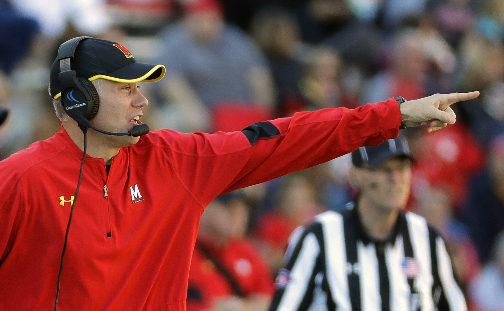 FILE - In this Oct. 15, 2016, file photo, Maryland head coach DJ Durkin directs his players in the second half of an NCAA college football game against Minnesota, in College Park, Md. Coming off the worst back-to-back losses in school history _ 59-3 and 6