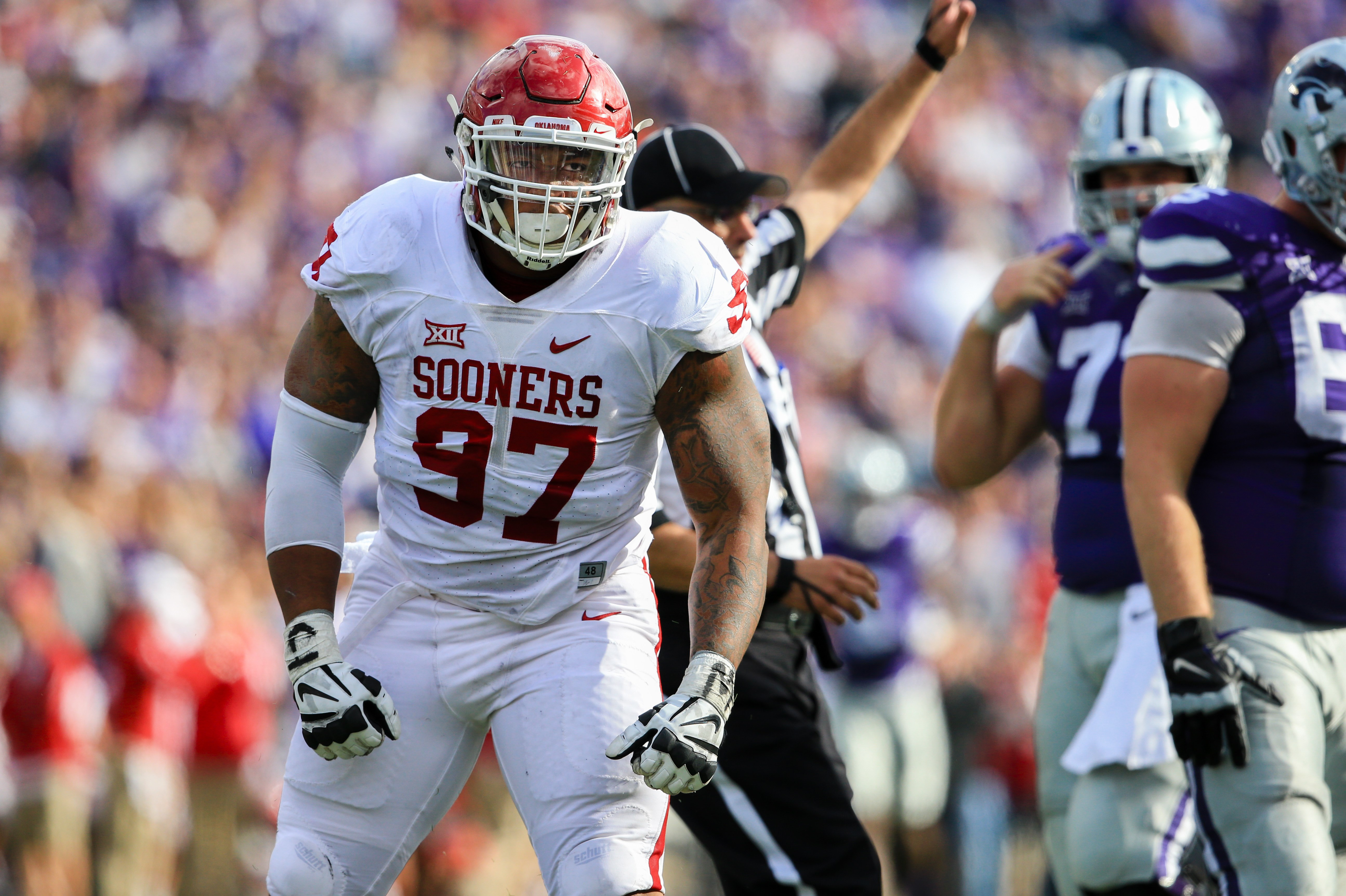 FILE - In this Oct. 17, 2015, file photo, Oklahoma defensive tackle Charles Walker (97) celebrates a tackle during the first half of an NCAA college football game against Kansas State in Manhattan, Kan. Ohio State coach Urban Myer admittedly worries about