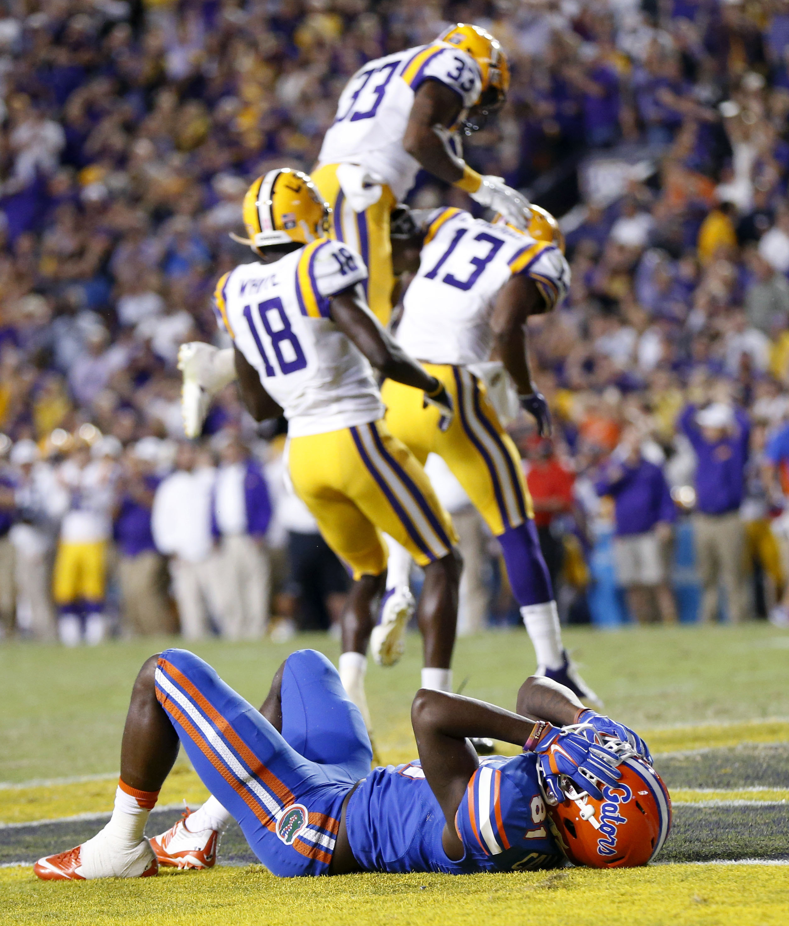 FILE - In this Oct. 17, 2015, file photo, Florida wide receiver Antonio Callaway (81) reacts as LSU celebrates after he dropped a pass in the end zone in the second half of an NCAA college football game in Baton Rouge, La. Florida's visit to LSU this week
