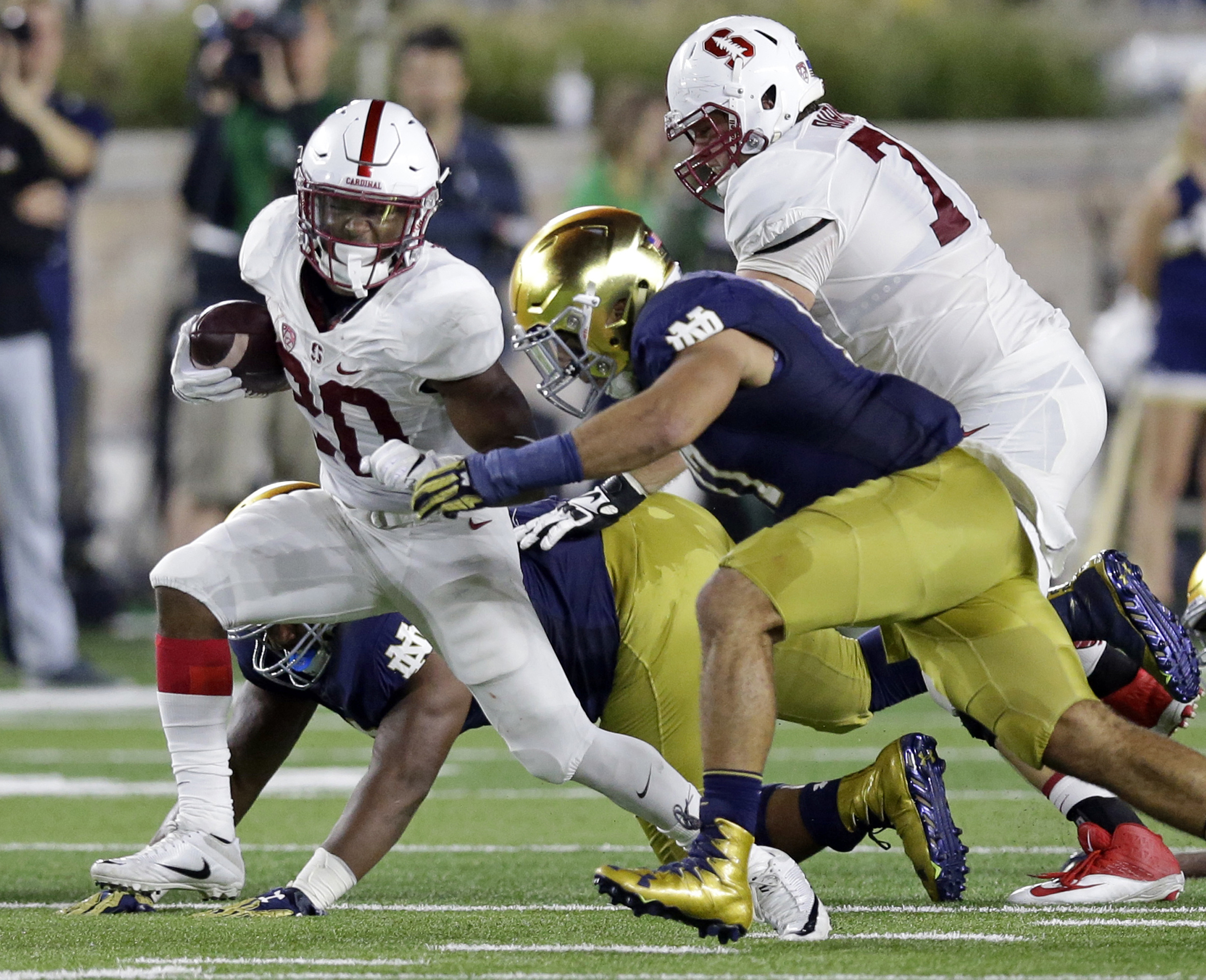 FILE - In this Oct. 15, 2016, file photo, Notre Dame linebacker James Onwualu (17) tackles Stanford running back Bryce Love (20) during the first quarter of an NCAA college football game in South Bend, Ind. Its been quite a journey for Onwualu going from