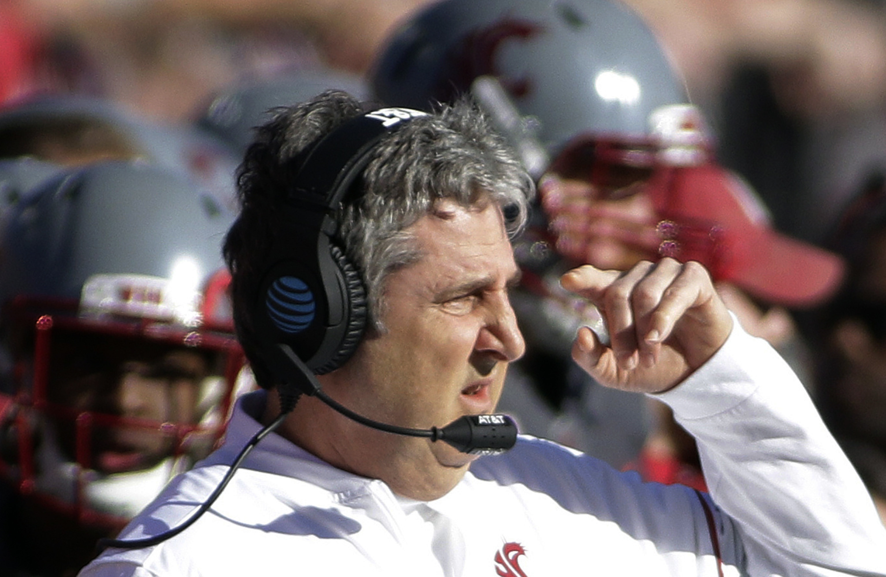 FILE - In this Nov, 5, 2016, file photo, Washington State head coach Mike Leach directs his team during the first half of an NCAA college football game against Arizona in Pullman, Wash. Leach has been one of the best program-builders in coaching over the