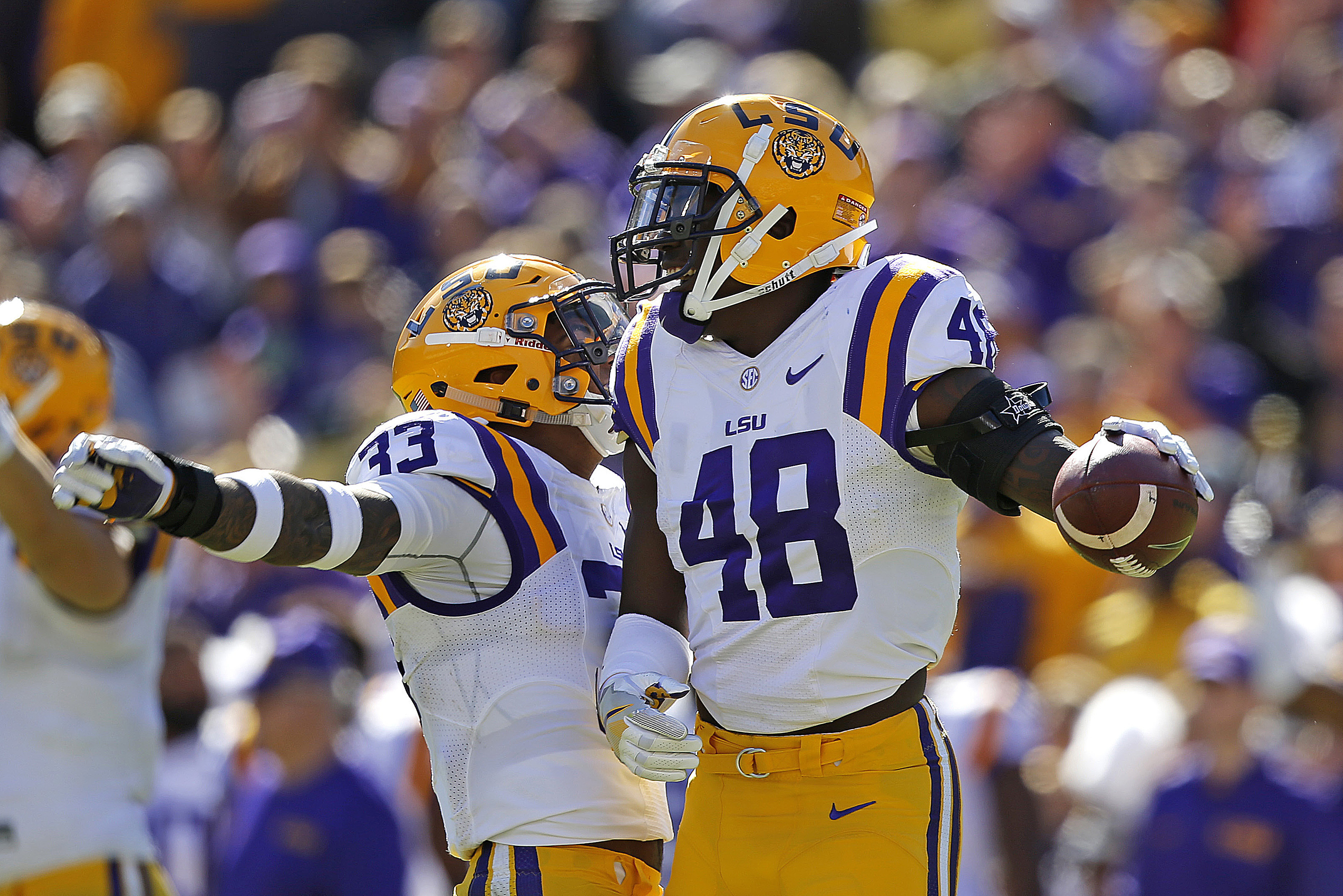 LSU linebacker Donnie Alexander (48) and fullback Trey Gallman (33) celebrate a defensive stop on a punt in the first half an NCAA college football game against Florida in Baton Rouge, La., Saturday, Nov. 19, 2016. (AP Photo/Gerald Herbert)