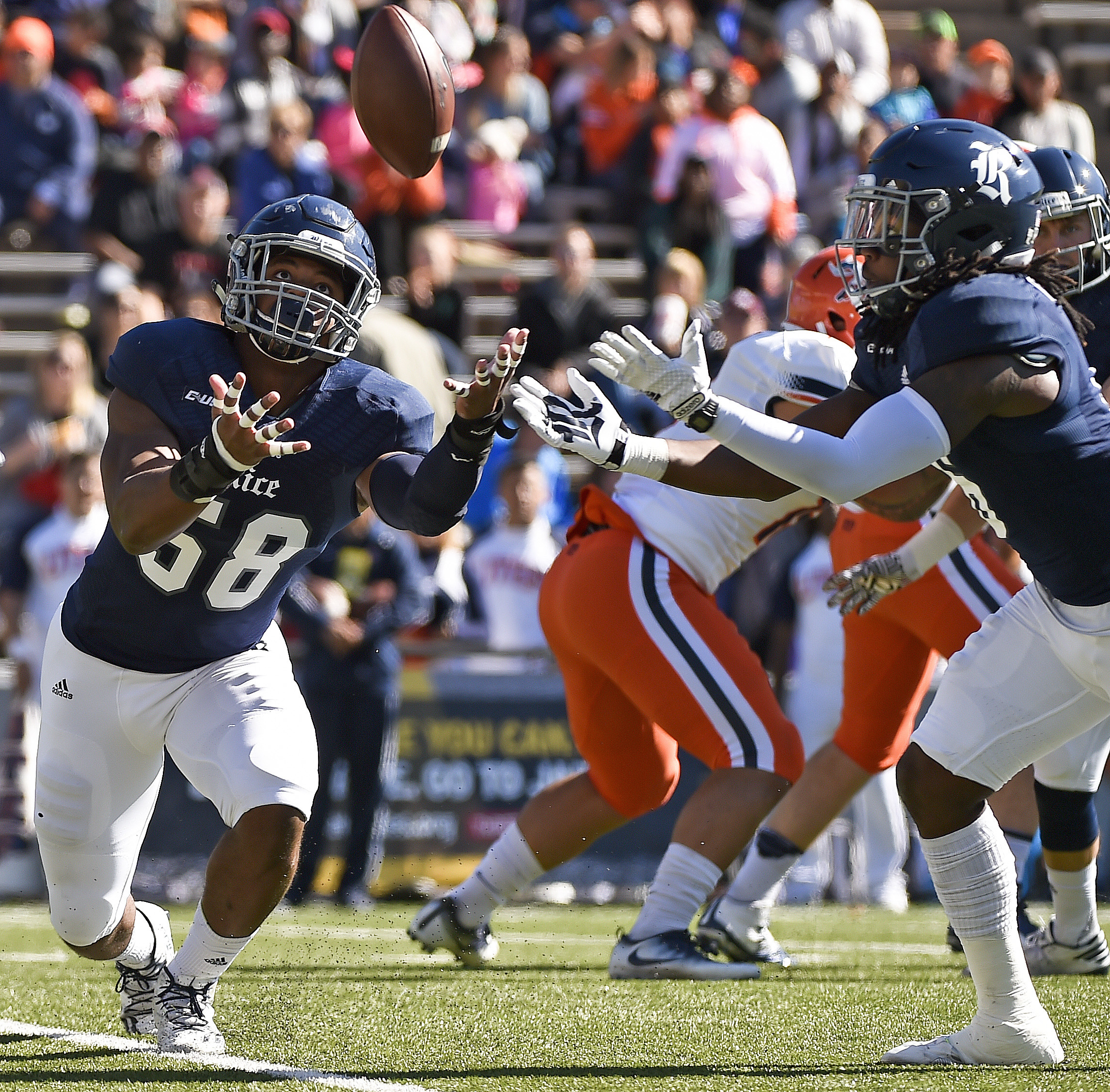 Rice linebacker Emmanuel Ellerbee, left, and safety Destri White try to catch a deflected pass during the first half of an NCAA college football game against UTEP, Saturday, Nov. 19, 2016, in Houston. (AP Photo/Eric Christian Smith)