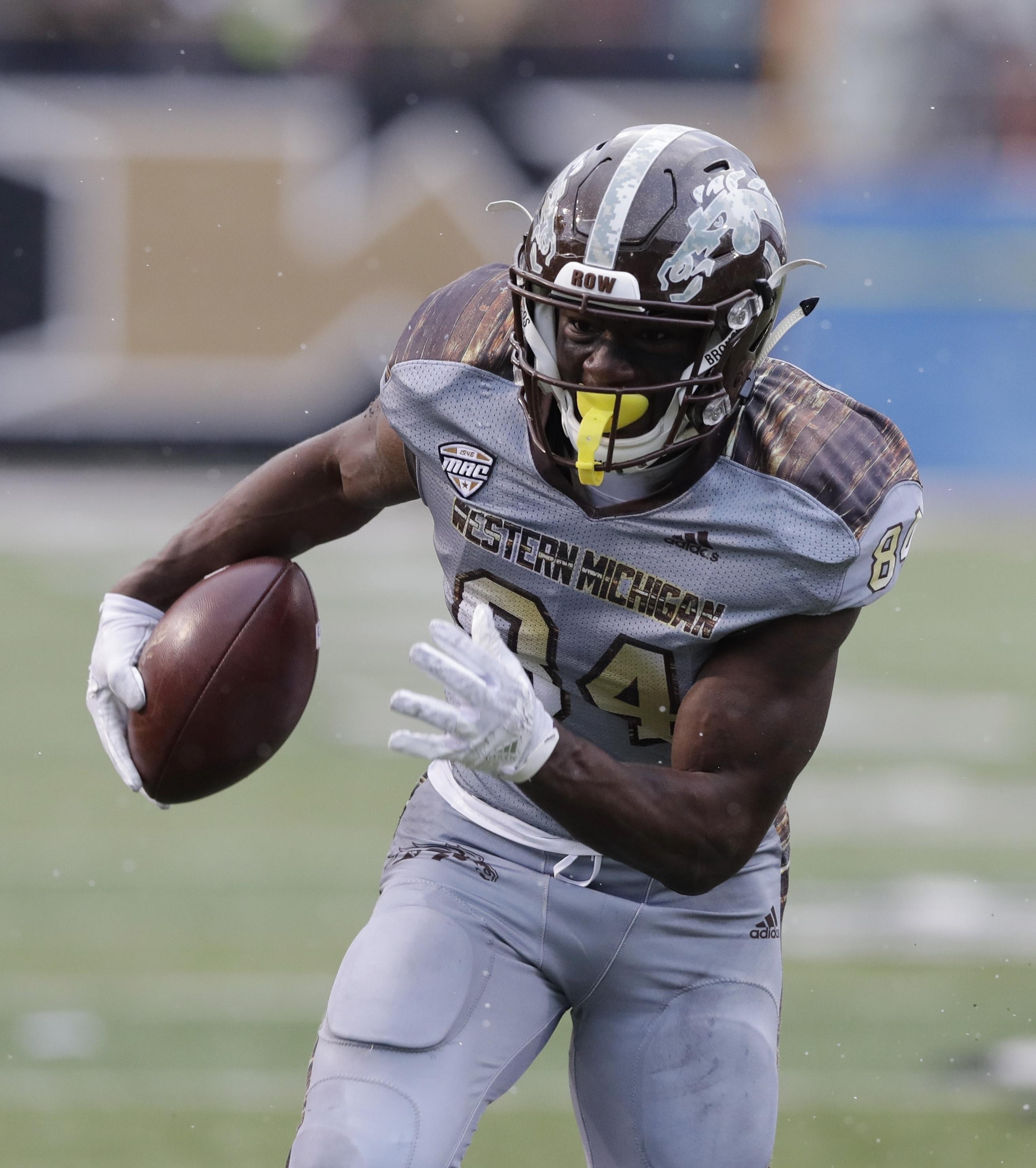 Western Michigan wide receiver Corey Davis (84) runs for a touchdown during the first half of an NCAA college football game against Buffalo, Saturday, Nov. 19, 2016, in Kalamazoo, Mich. (AP Photo/Carlos Osorio)