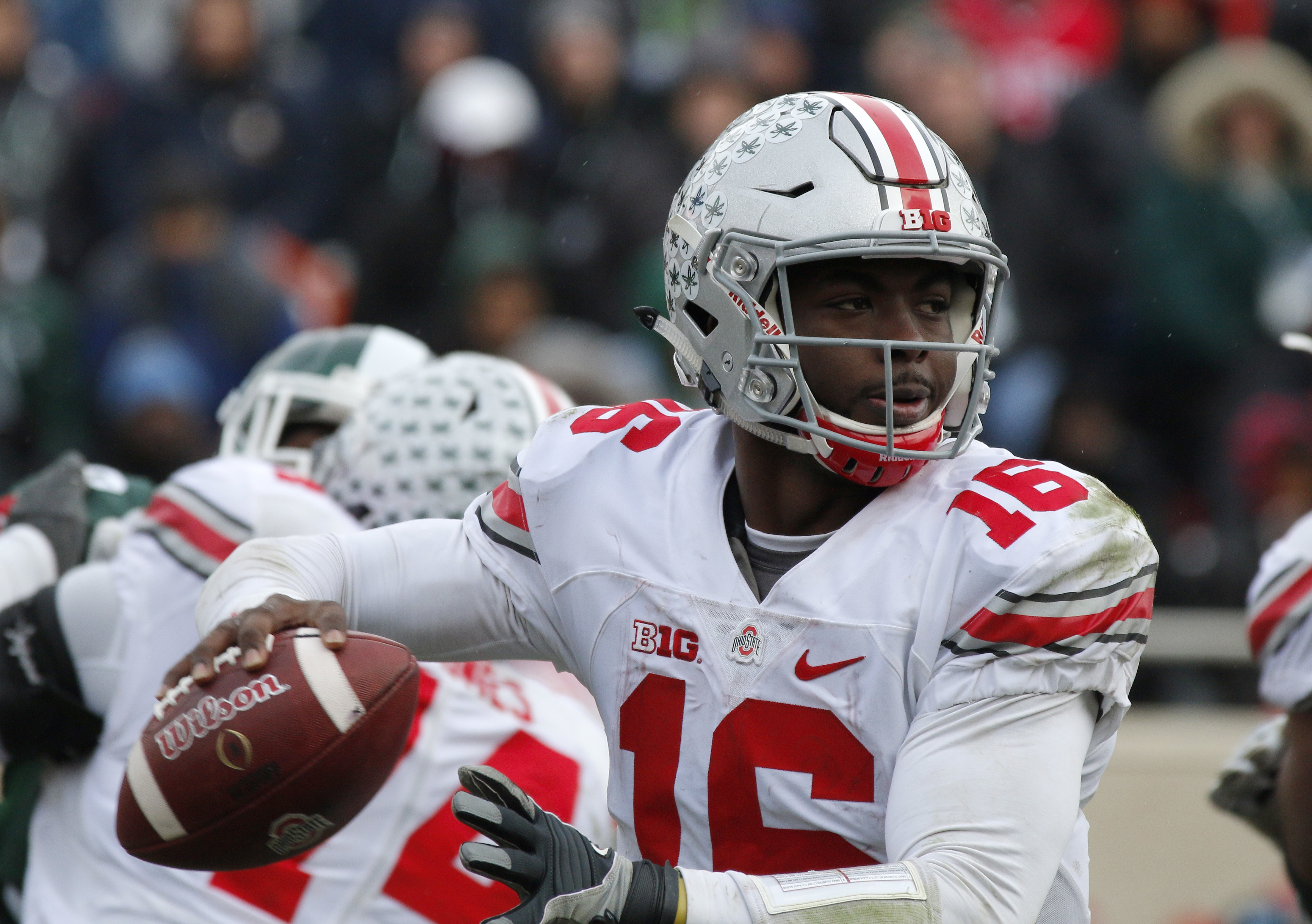 Ohio State quarterback J.T. Barrett looks to throw against Michigan State during the fourth quarter half of an NCAA college football game, Saturday, Nov. 19, 2016, in East Lansing, Mich. Ohio State won 17-16. (AP Photo/Al Goldis)