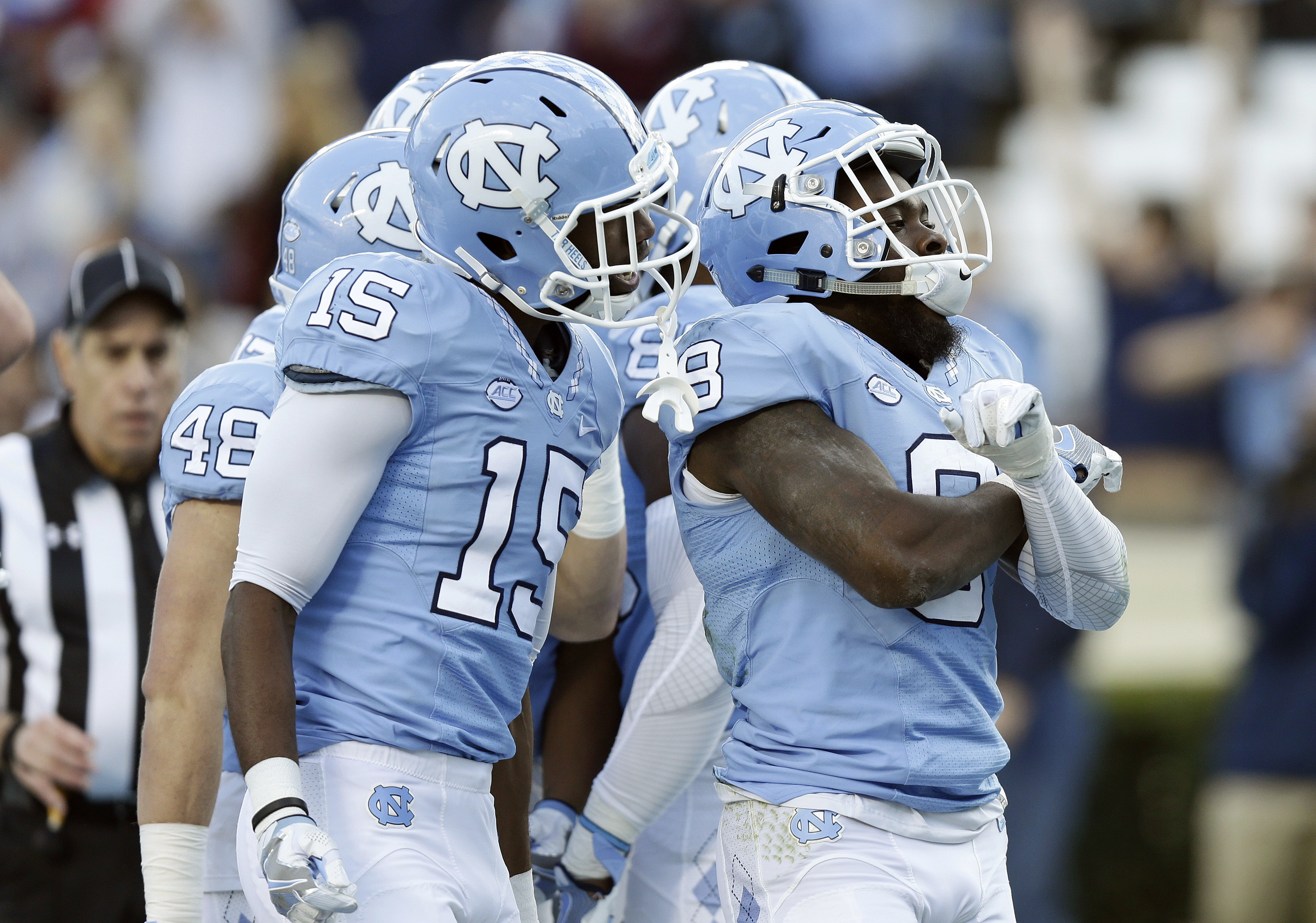 North Carolina's T.J. Logan (8) and Jordan Cunningham (15) celebrate Logan's touchdown against The Citadel during the first half of an NCAA college football game in Chapel Hill, N.C., Saturday, Nov. 19, 2016. (AP Photo/Gerry Broome)