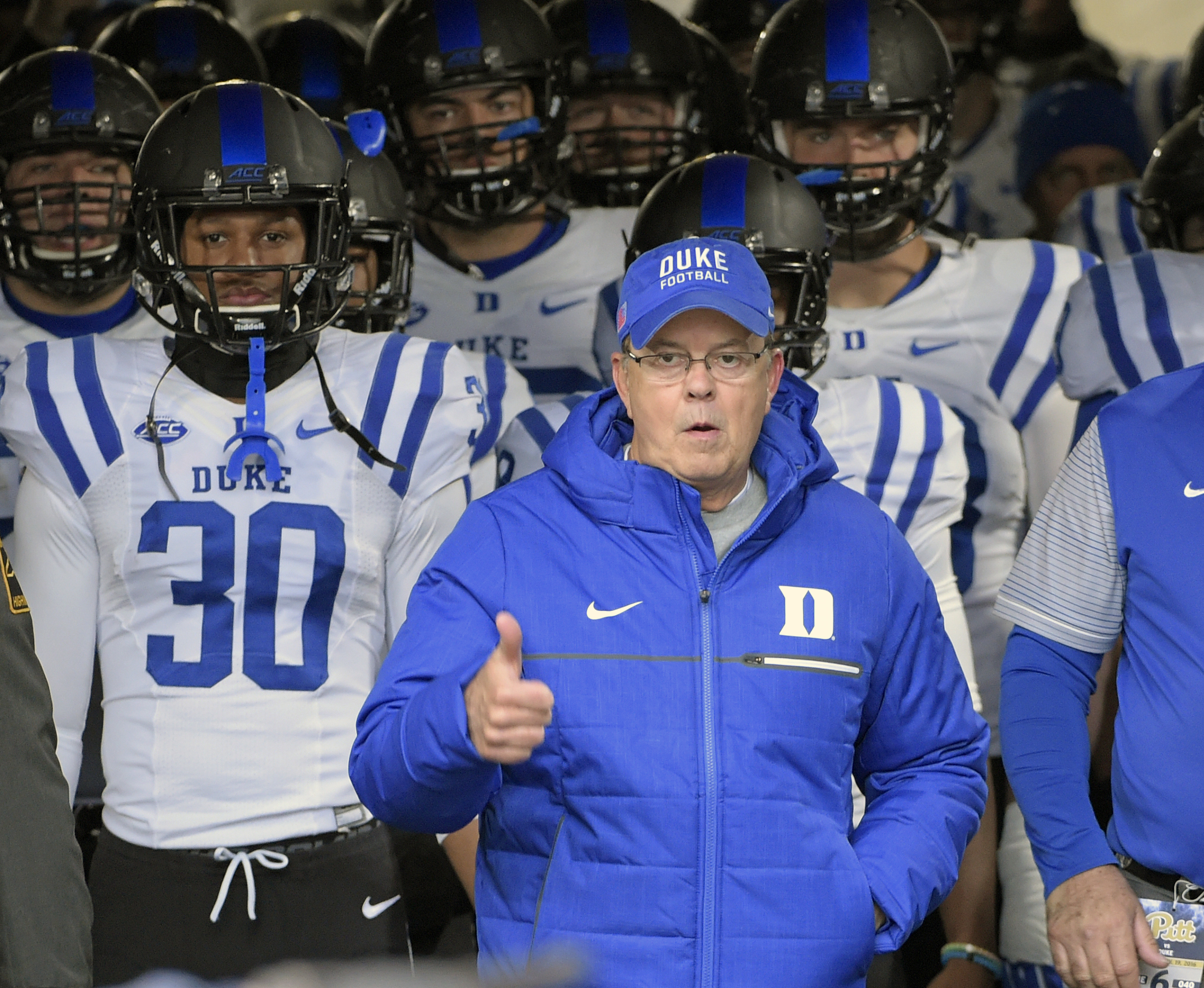 Duke head coach David Cutcliffe leads his team onto the field at the start of an NCAA college football game against the Pittsburgh Panthers in Pittsburgh, Saturday, Nov. 19, 2016. (AP Photo/Fred Vuich)