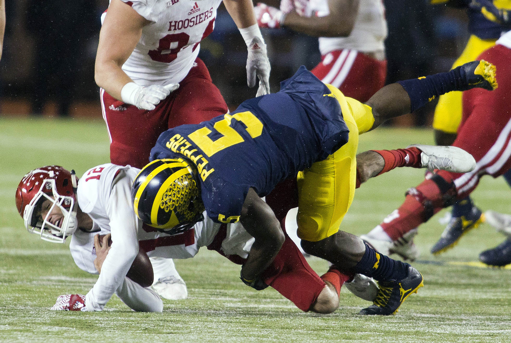 Indiana quarterback Zander Diamont (12) is sacked by Michigan linebacker Jabrill Peppers (5) in the fourth quarter of an NCAA college football game in Ann Arbor, Mich., Saturday, Nov. 19, 2016. Michigan won 20-10. (AP Photo/Tony Ding)