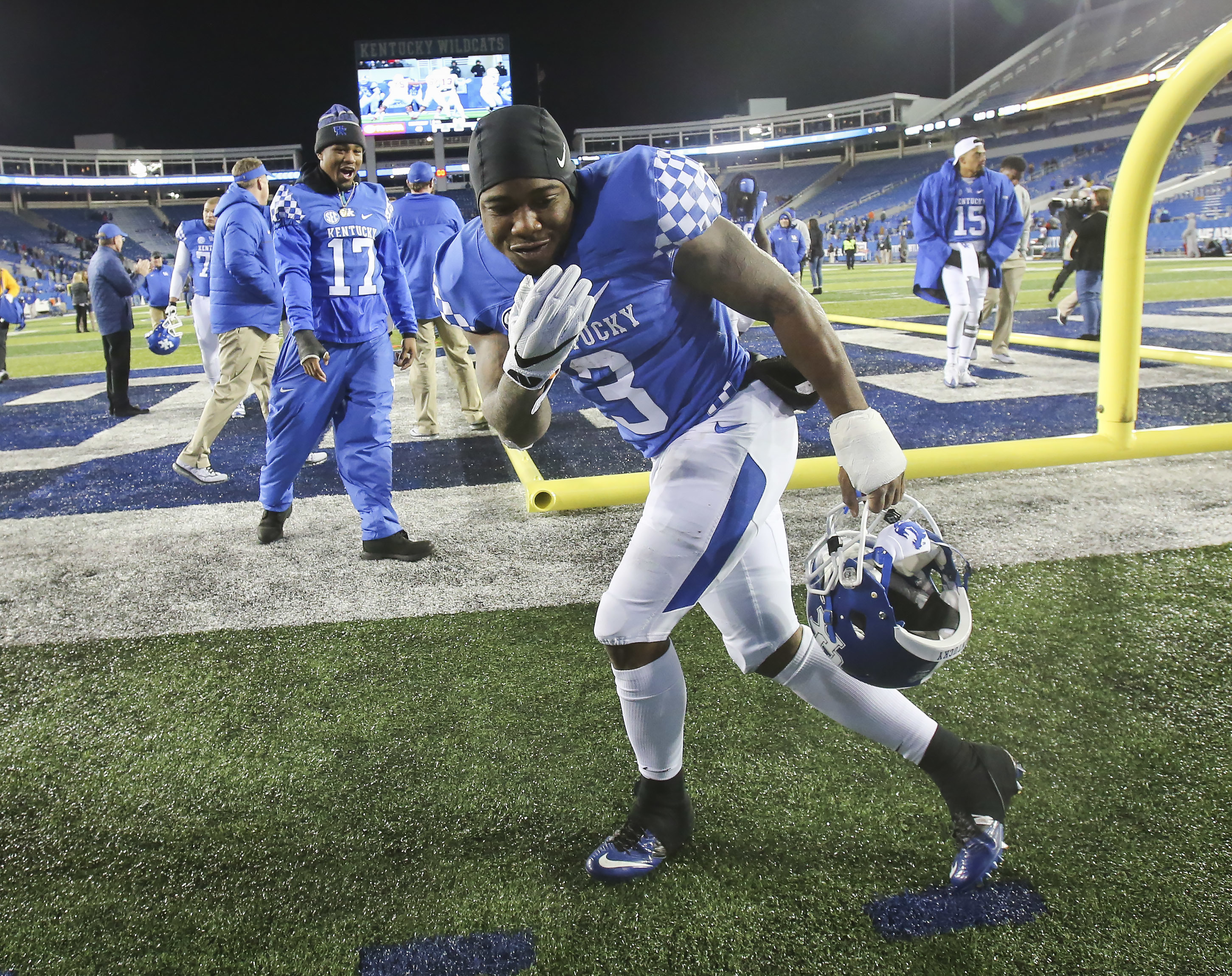 Kentucky running back Jojo Kemp strikes a bowling pose after his team earned a bowl bid by defeating Austin Peay 49-13 in an NCAA college football game Saturday, Nov. 19, 2016, in Lexington, Ky. (AP Photo/David Stephenson)