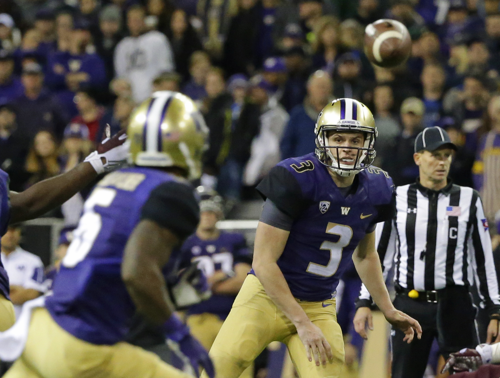 Washington quarterback Jake Browning (3) passes to wide receiver Chico McClatcher, left, in the second half of an NCAA college football game against Arizona State, Saturday, Nov. 19, 2016, in Seattle. Washington beat Arizona State 44-18. (AP Photo/Ted S.