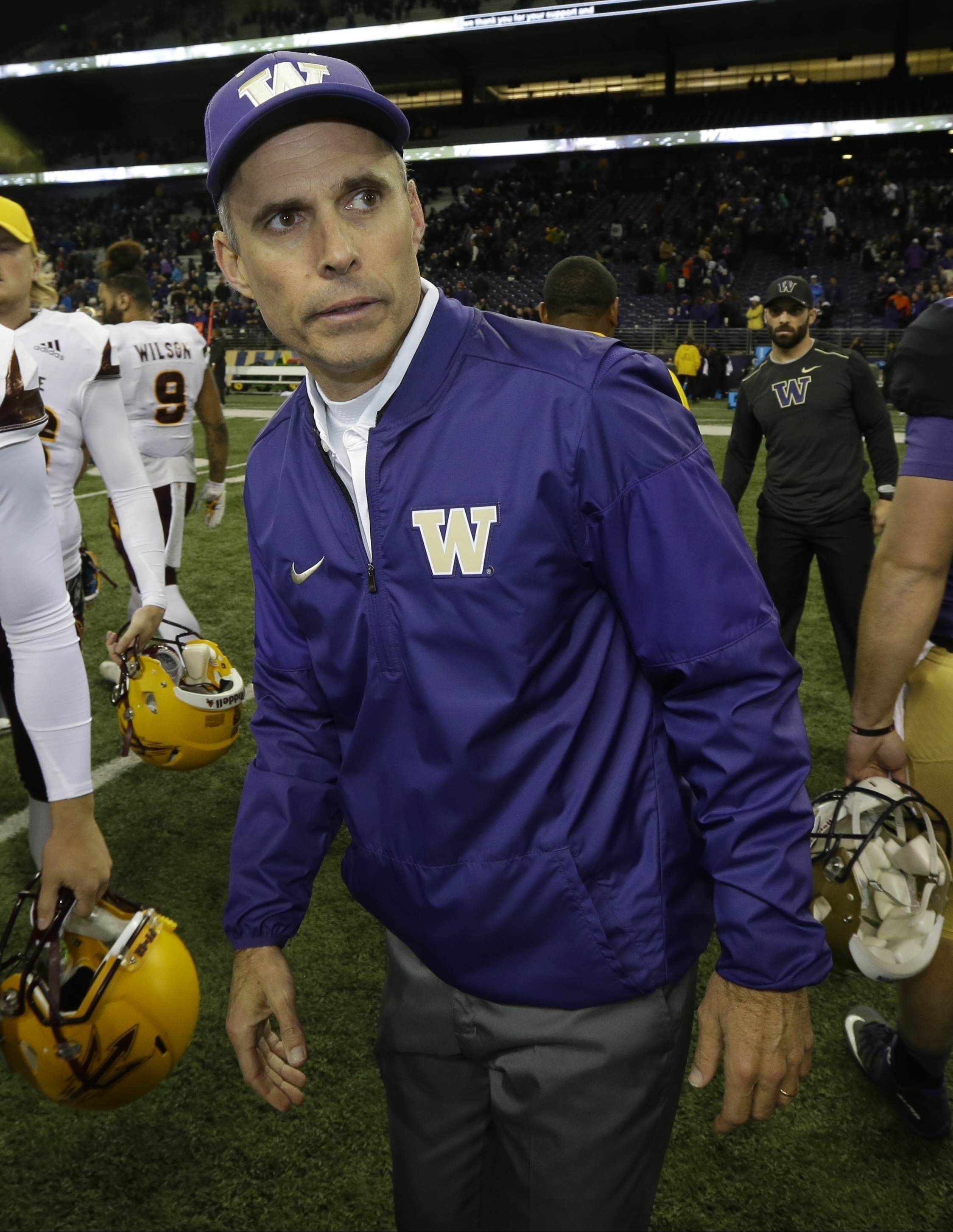 FILE - In this Nov. 19, 2016, file photo, Washington head coach Chris Petersen walks on the field after an NCAA college football game against Arizona State, in Seattle. Washington is two victories away from its first Pac-12 championship since 2000 and may