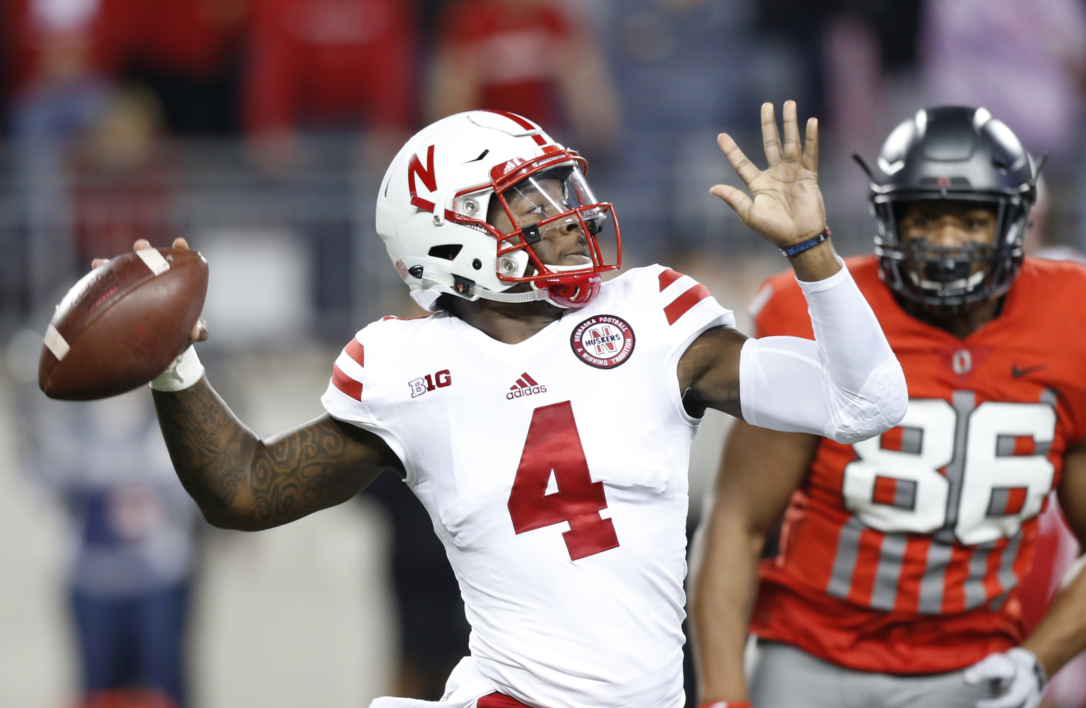 FILE - In this Nov. 5, 2016, file photo, Nebraska quarterback Tommy Armstrong throws a pass against Ohio State during the first half of an NCAA college football game in Columbus, Ohio. Nebraska plays at Iowa on Friday. (AP Photo/Jay LaPrete, File)