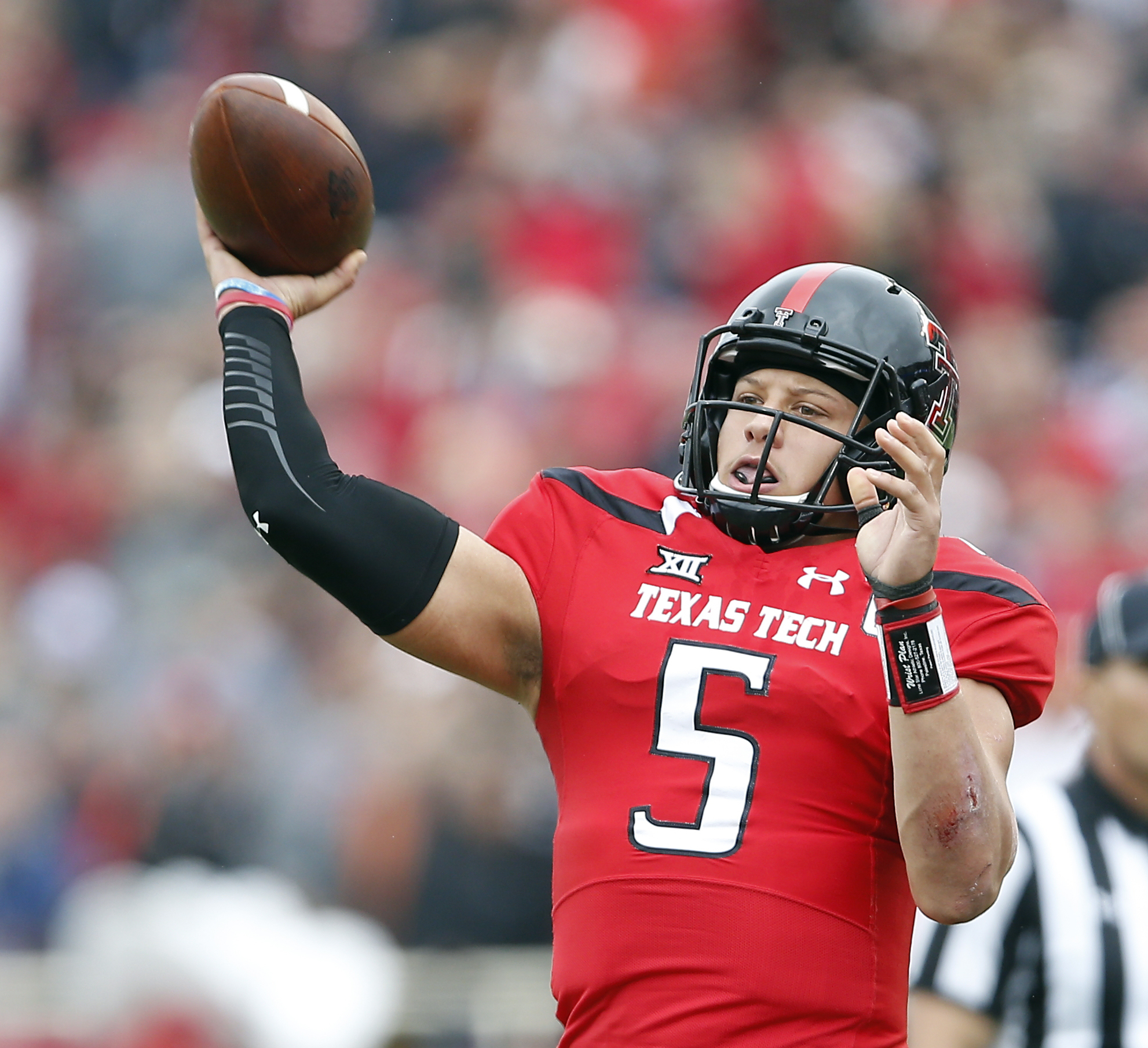 FILE - In this Nov. 5, 2016, file photo, Texas Tech's Patrick Mahomes (5) passes the ball during an NCAA college football game against Texas, in Lubbock, Texas. The closest Texas Tech and junior quarterback Patrick Mahomes will get to a bowl game this sea