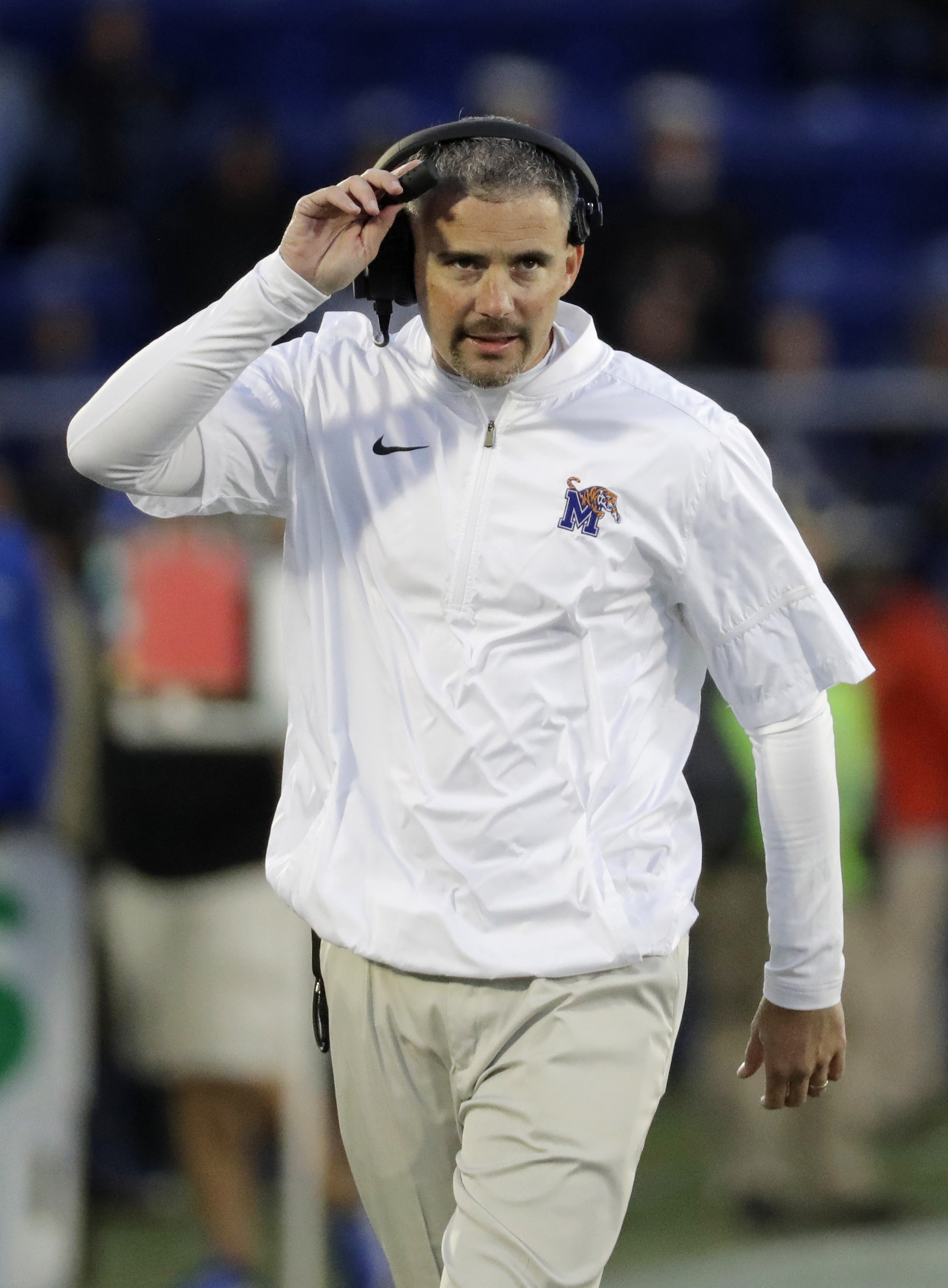 FILE - In this Oct. 22, 2016, file photo, Memphis head coach Mike Norvell walks on the field in the second half of an NCAA college football game against Navy in Annapolis, Md. Houston plays Memphis on Saturday. (AP Photo/Patrick Semansky, File)