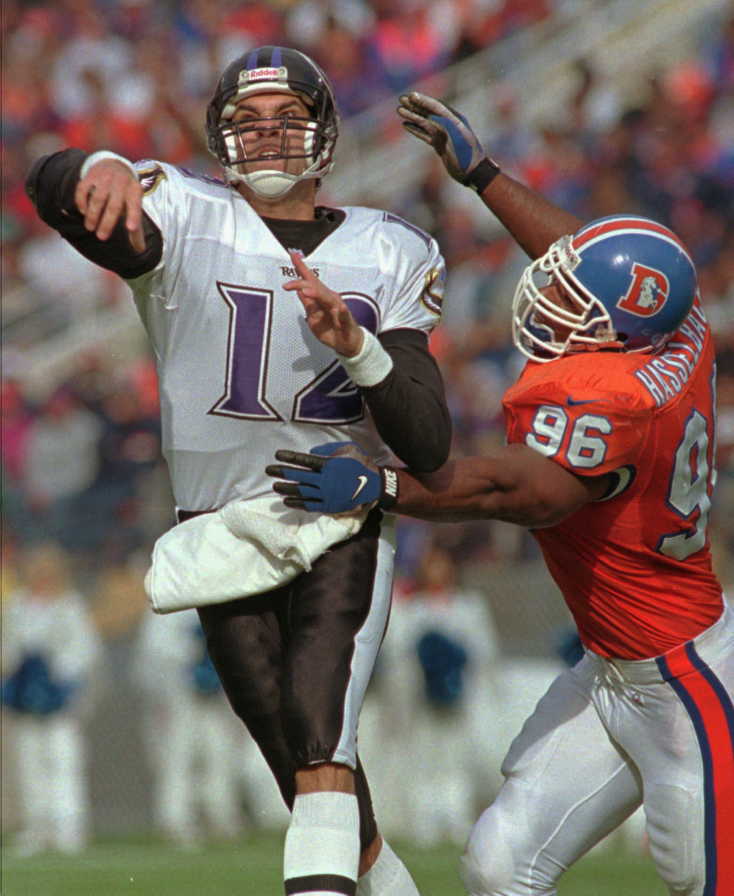 FILE - In this Oct. 20, 1996, file photo, Denver Broncos defensive end Harold Hasselbach, right, pressures Baltimore Ravens quarterback Vinny Testaverde during an NFL football game in Denver. Hasselbach's son Terran is a hybrid linebacker at Colorado. The