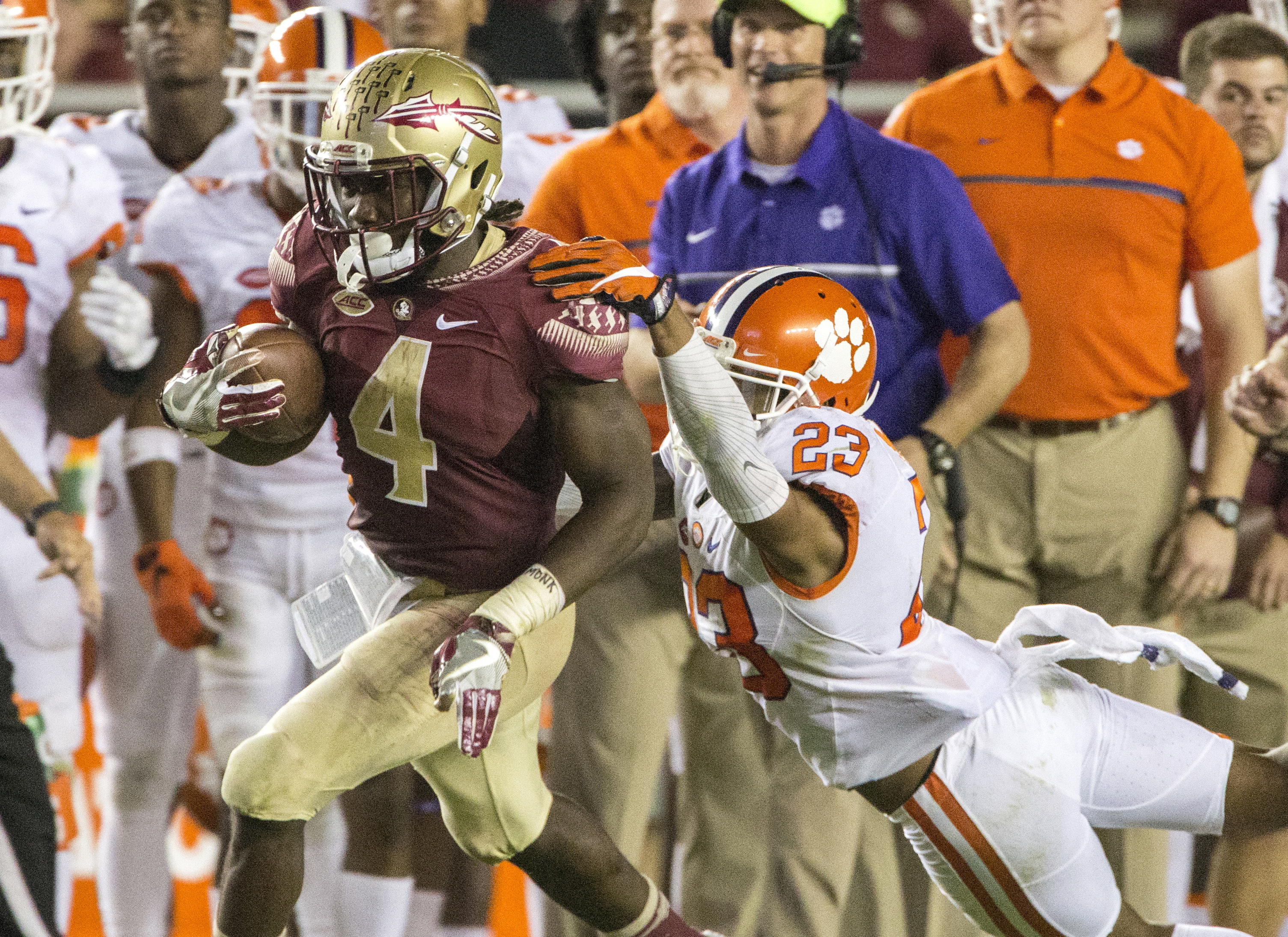 FILE - In this Saturday, Oct. 29, 2016, file photo, Florida State running back Dalvin Cook (4) sheds Clemson safety Van Smith during a 70-yard touchdown run in the second half of an NCAA college football game in Tallahassee, Fla. Slowing down Cook is Flor