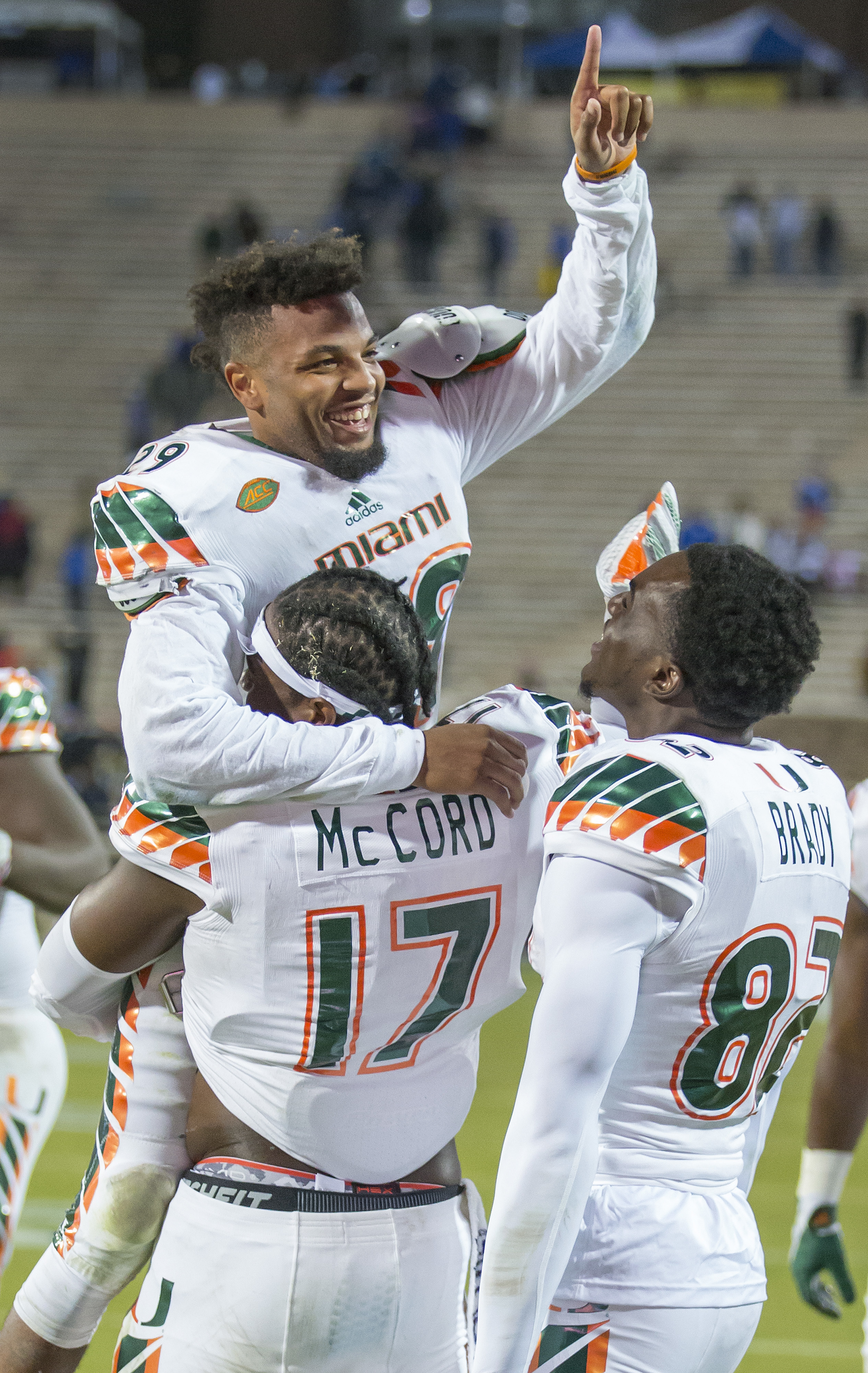 FILE - In this Saturday, Oct. 31, 2015, file photo, Miami's Corn Elder celebrates with teammate Tyriq McCord (17) after he scored on a kickoff return to beat Duke 30-27 in an NCAA college football game, in Durham, N.C. Miami and Duke are set to meet Satur