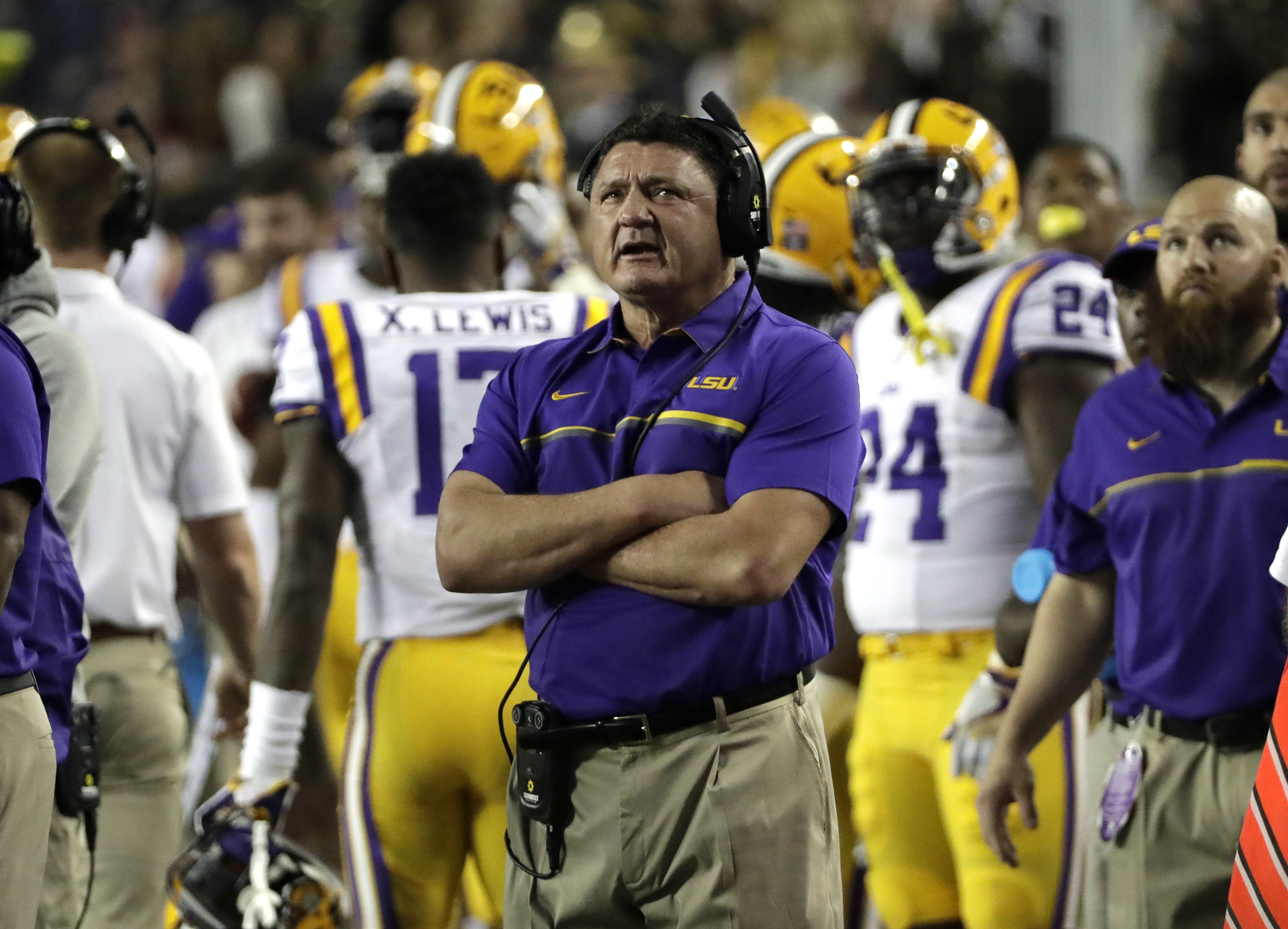 LSU coach Ed Orgeron looks up at the scoreboard after a Texas A&M touchdown during the first quarter of an NCAA college football game Thursday, Nov. 24, 2016, in College Station, Texas. (AP Photo/David J. Phillip)