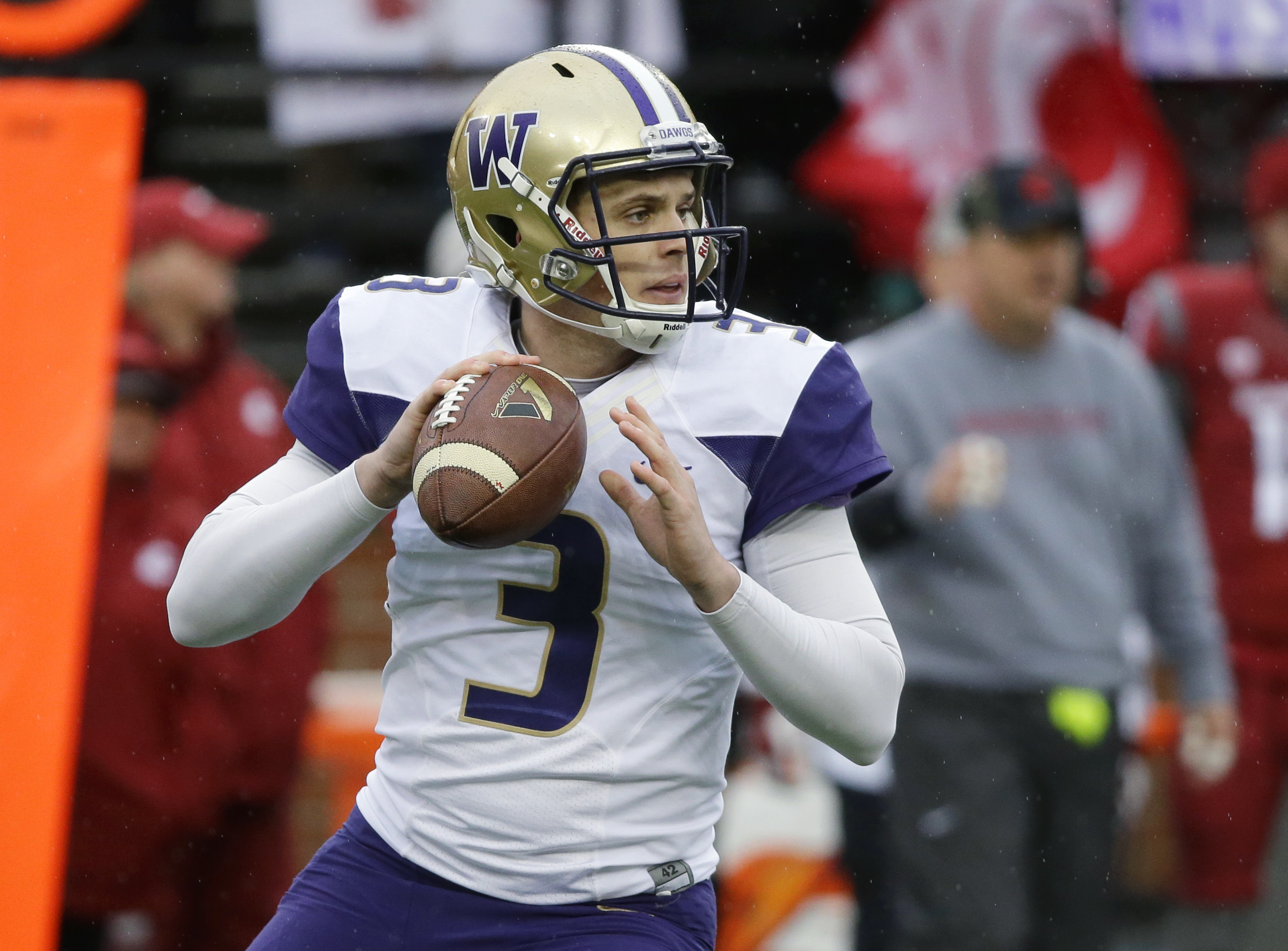 Washington quarterback Jake Browning passes against Washington State in the first half of an NCAA college football game, Friday, Nov. 25, 2016, in Pullman, Wash. (AP Photo/Ted S. Warren)