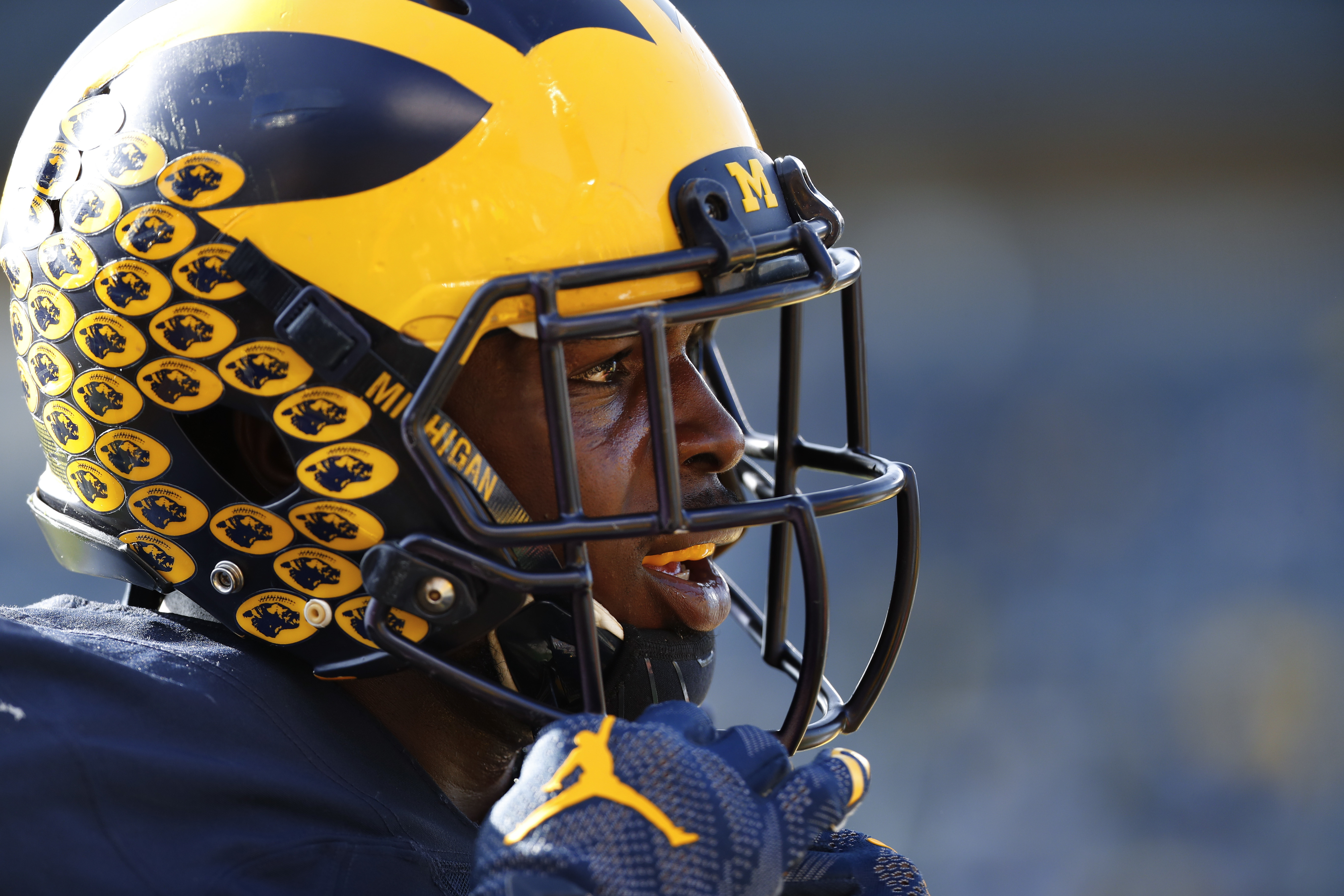FILE - In this Nov. 5, 2016, file photo, Michigan Wolverines linebacker Jabrill Peppers (5) watches during an NCAA college football game against Maryland, in Ann Arbor, Mich. The numbers strongly suggest they are two of the four, maybe five, best teams in