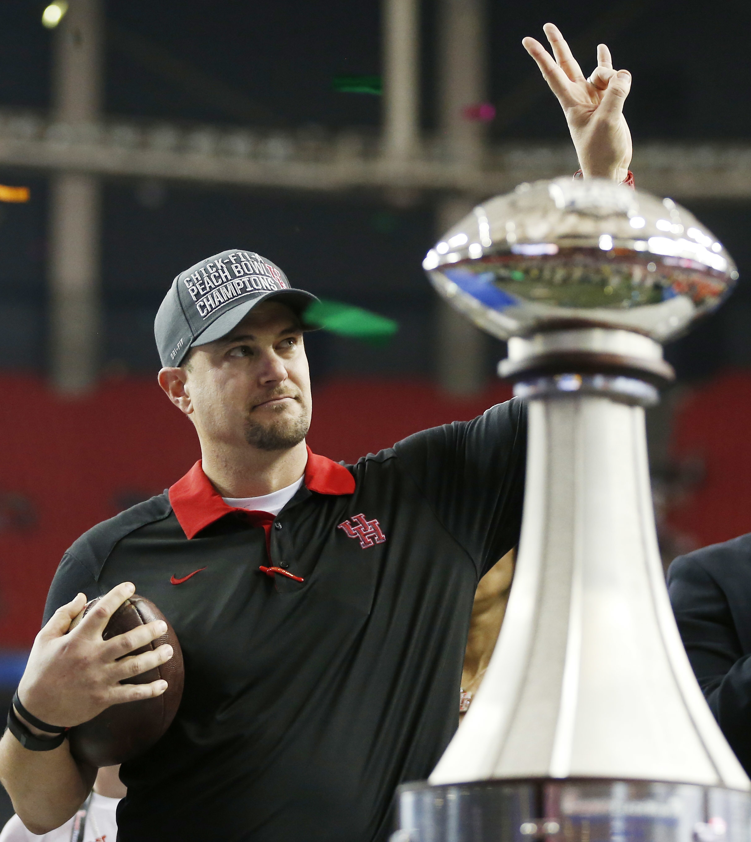 FILE - In this Dec. 31, 2015, file photo, Houston head coach Tom Herman celebrates after defeating Florida State 38-24 in the Peach Bowl NCAA college football game in Atlanta. A person with direct knowledge of the discussions says Herman has told the scho