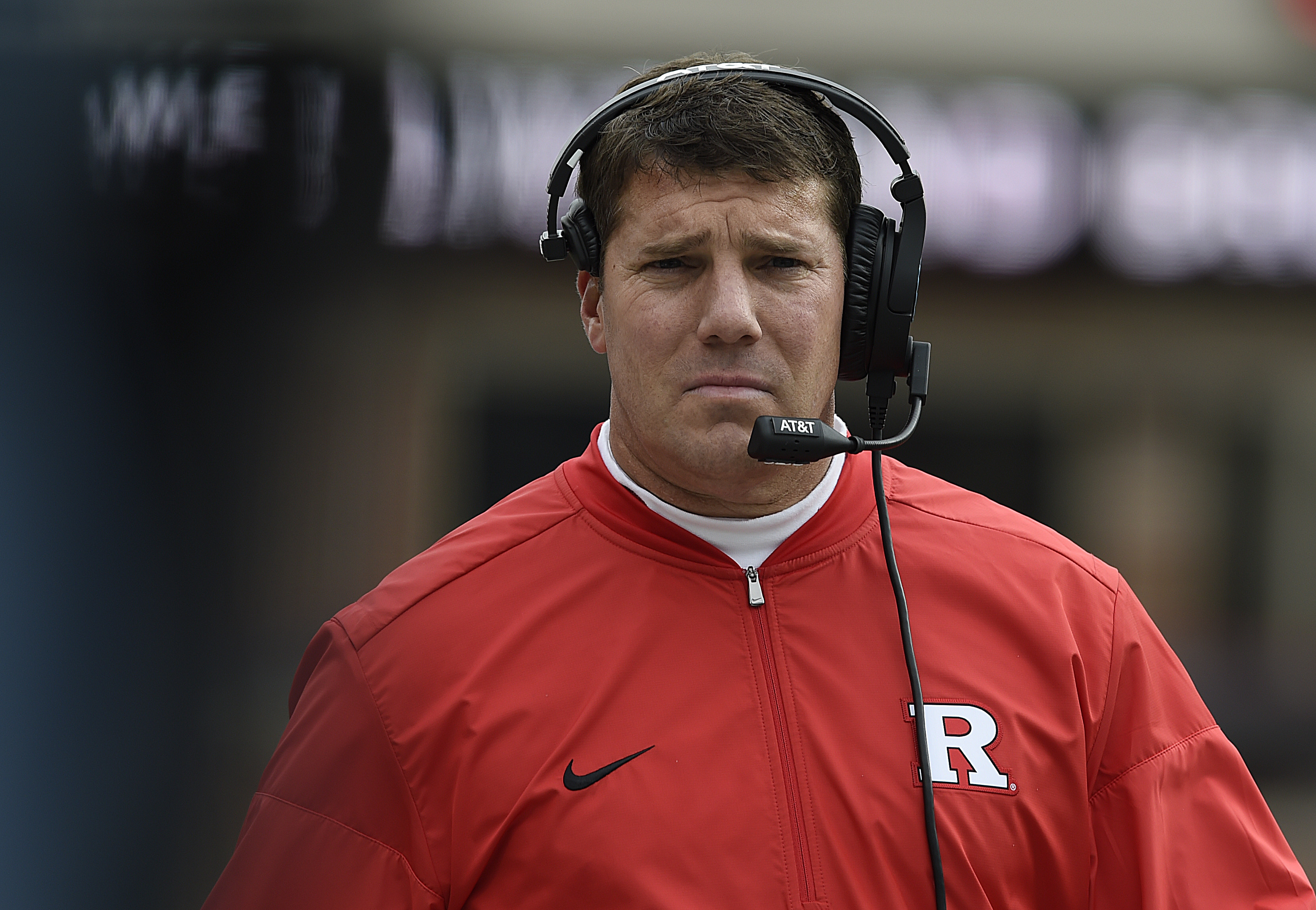 Rutgers head coach Chris Ash walks to the sideline after a timeout against Maryland during the first half of an NCAA college football game, Saturday, Nov. 26, 2016 in College Park, Md. Maryland won 31-13. (AP Photo/Gail Burton)
