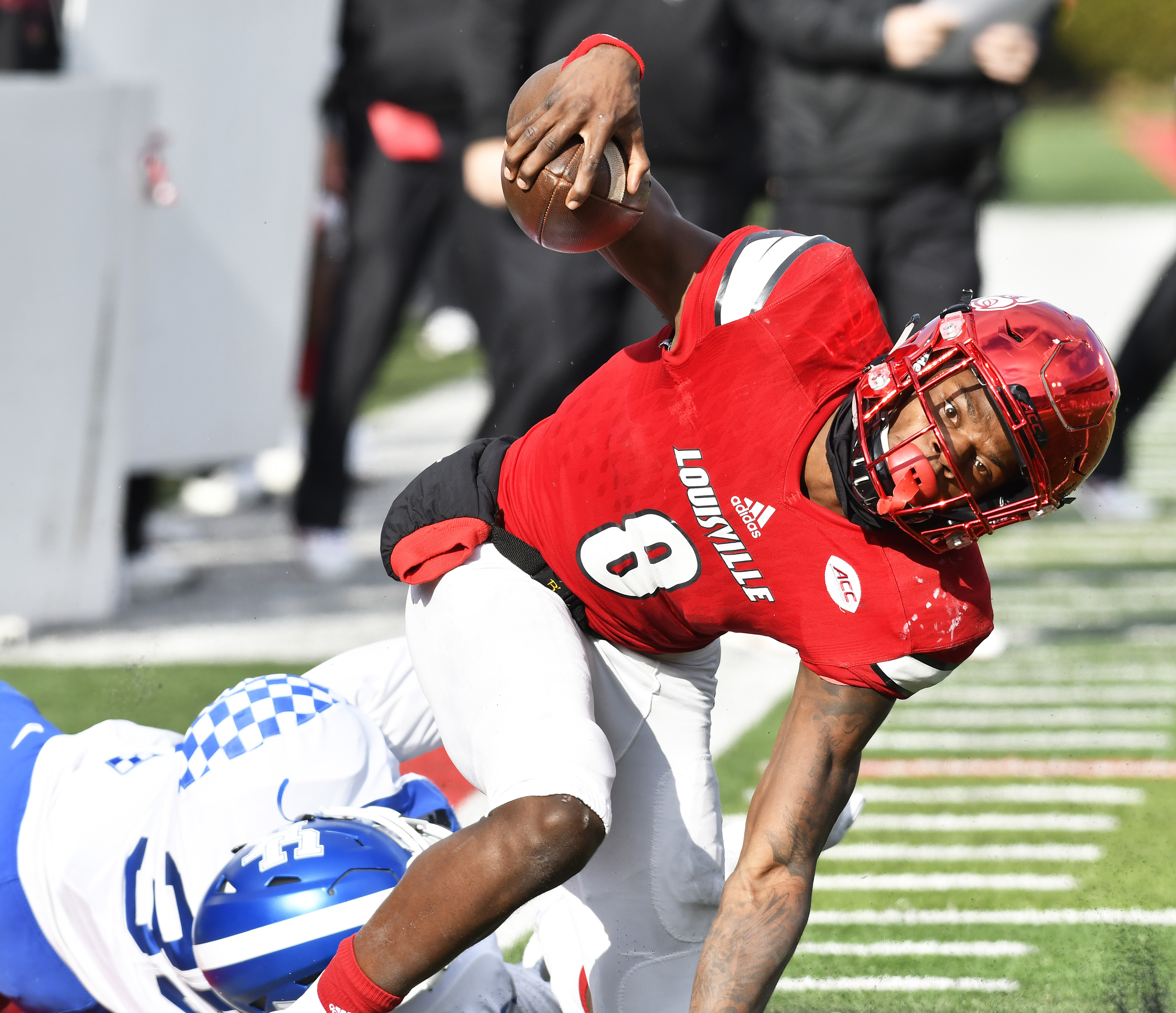 Louisville quarterback Lamar Jackson (8) is brought down by Kentucky's Denzil Ware (35) during the second half of an NCAA college football game, Saturday, Nov. 26, 2016, in Louisville, Ky. Kentucky won 41-38. (AP Photo/Timothy D. Easley)