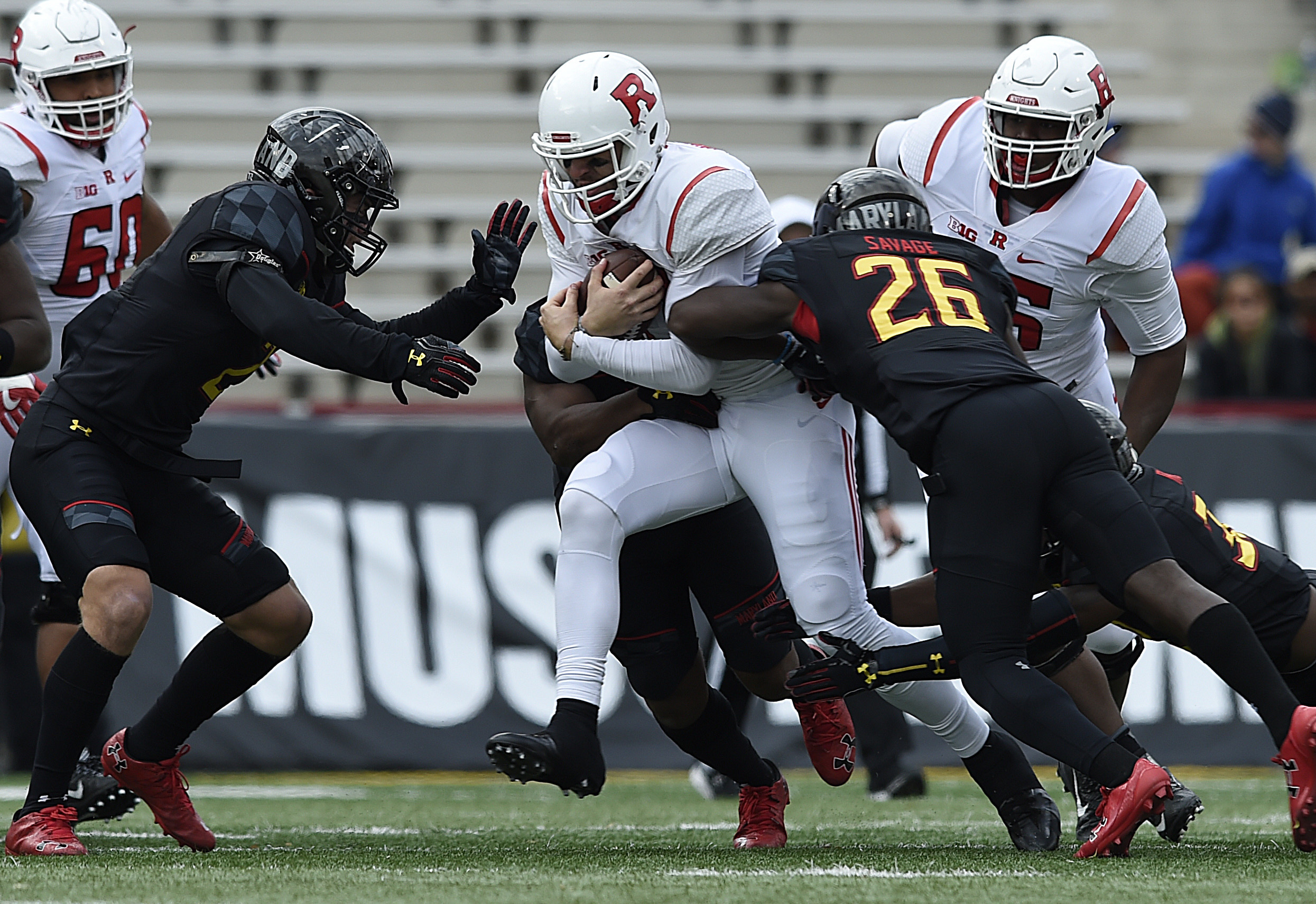 Rutgers quarterback Giovanni Rescigno, center, rushes as Maryland players Shane Cockerille, left, and Darnell Savage Jr. tackle during the first half of an NCAA college football game, Saturday, Nov. 26, 2016 in College Park, Md. Maryland won 31-13. (AP Ph