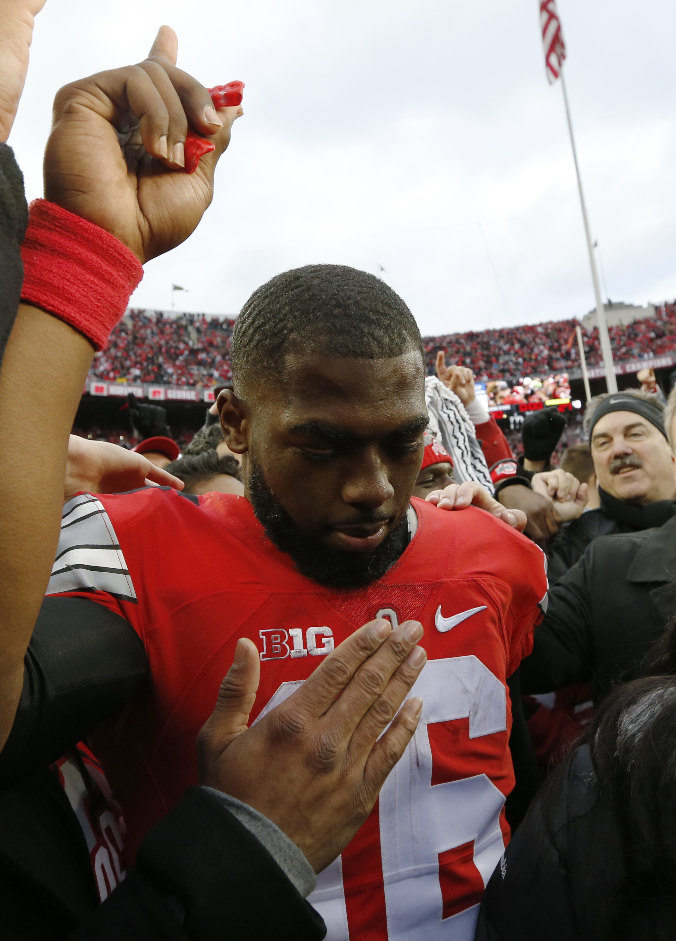 Ohio State quarterback J.T. Barrett celebrates with fans after their win over Michigan in an NCAA college football game Saturday, Nov. 26, 2016, in Columbus, Ohio. Ohio State beat Michigan 30-27 in double overtime. (AP Photo/Jay LaPrete)