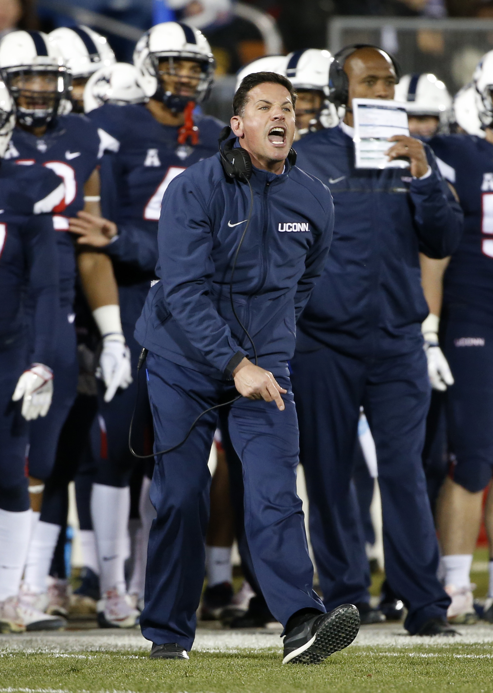 Connecticut head coach Bob Diaco yells to his team during the second half of an NCAA college football game against Tulane in East Hartford, Conn., Saturday, Nov. 26, 2016. (AP Photo/Mary Schwalm)
