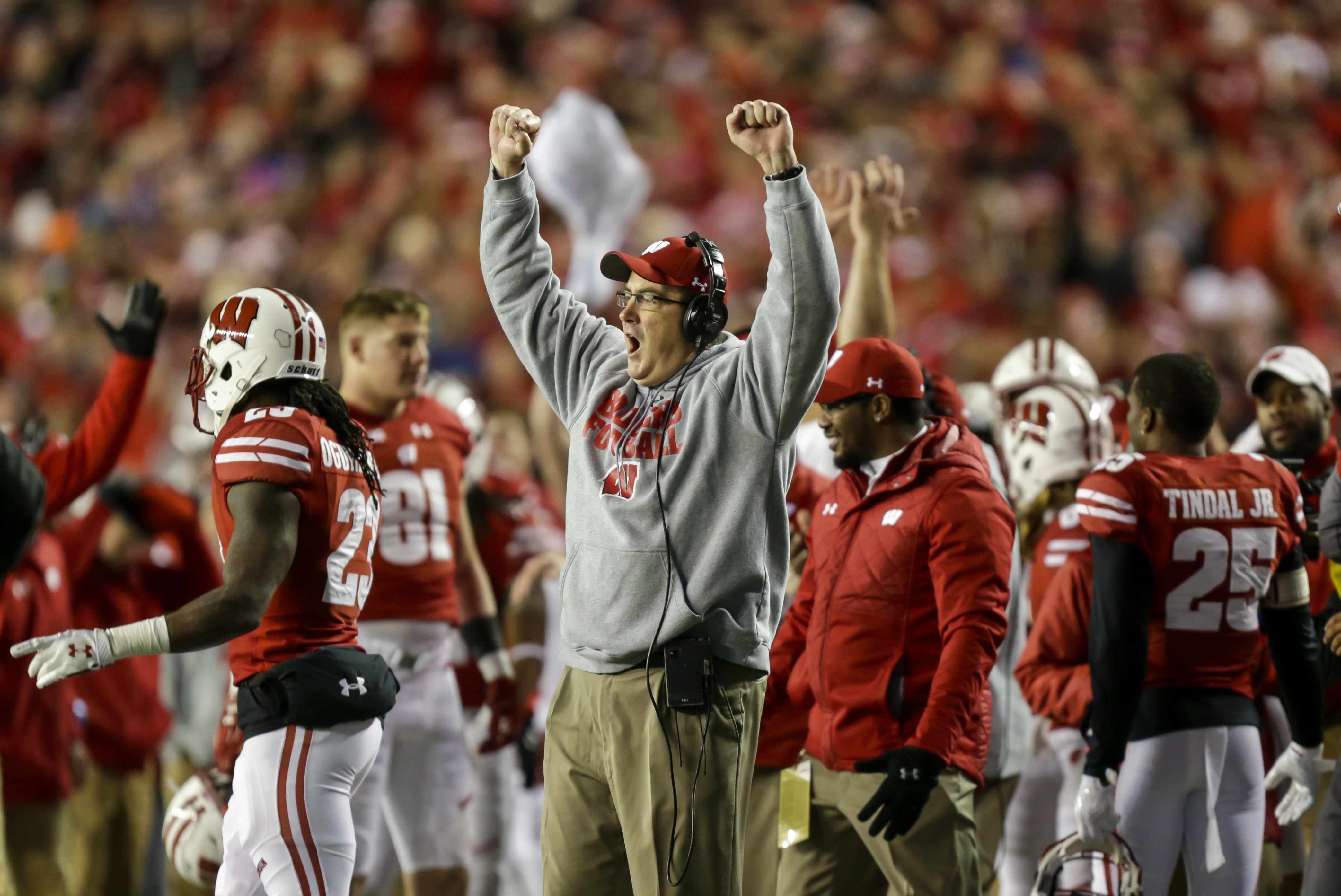 Wisconsin coach Paul Chryst celebrates after a touchdown against Minnesota during the second half of an NCAA college football game Saturday, Nov. 26, 2016, in Madison, Wis. Wisconsin won 31-17. (AP Photo/Andy Manis)