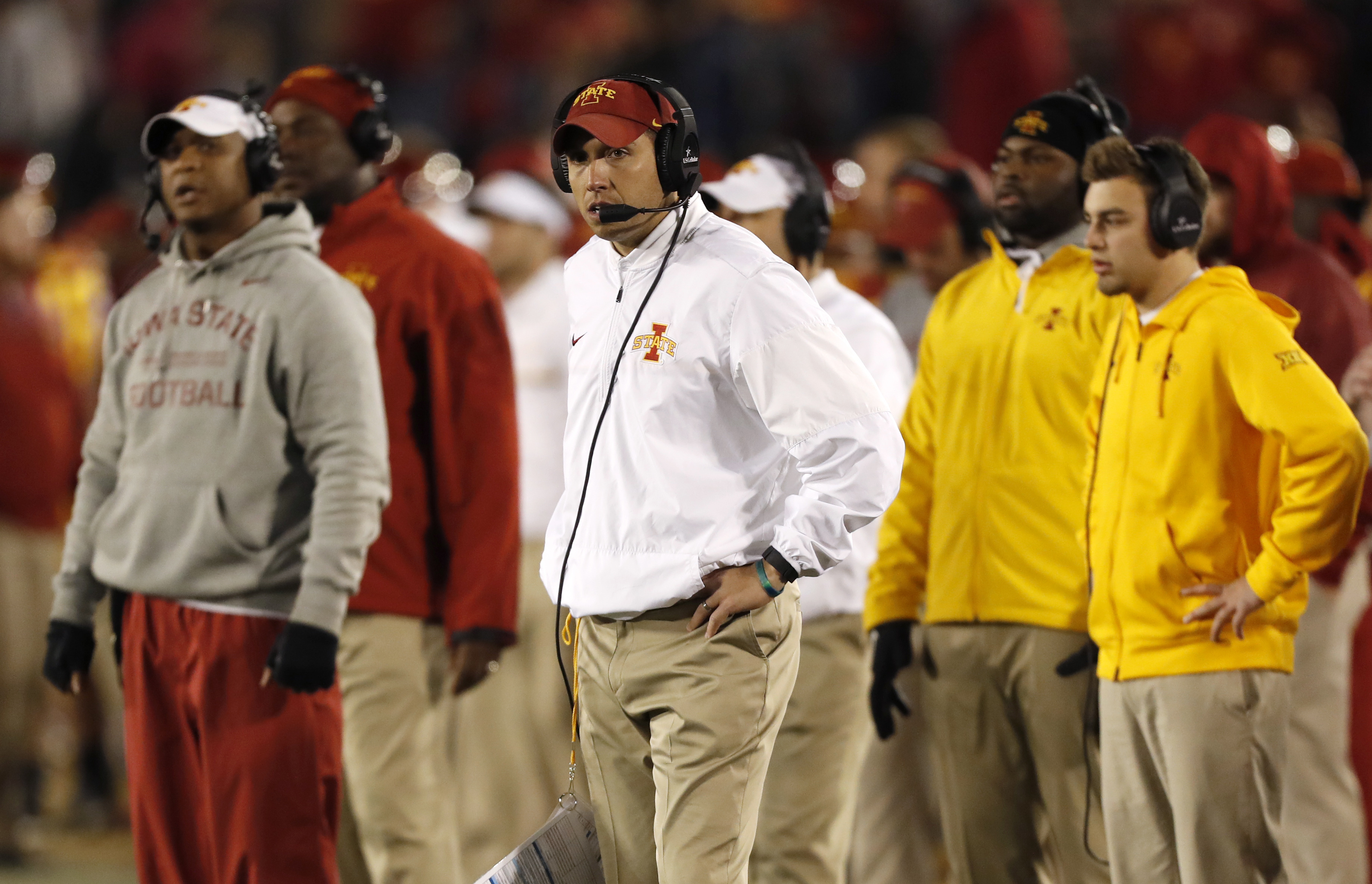 Iowa State head coach Matt Campbell, center, watches from the sideline during the second half of an NCAA college football game against West Virginia, Saturday, Nov. 26, 2016, in Ames, Iowa. (AP Photo/Charlie Neibergall)