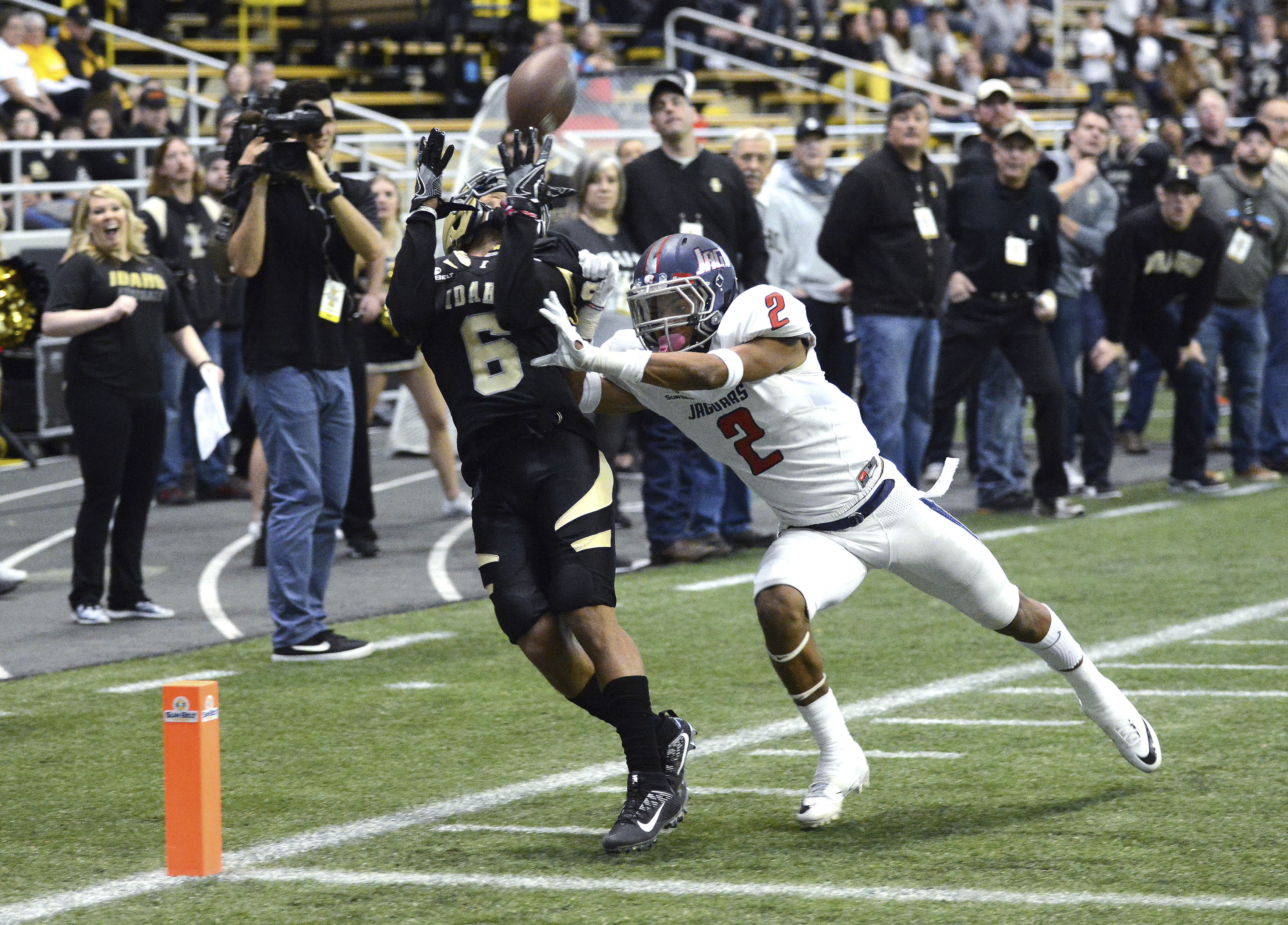 Idaho's Callen Hightower (6) makes a touchdown reception in front of South Alabama's Jalen Thompson (2) during the second quarter of an NCAA college football game Saturday, Nov. 26, 2016, in Moscow, Idaho. (Kyle Mills/Lewiston Tribune via AP)