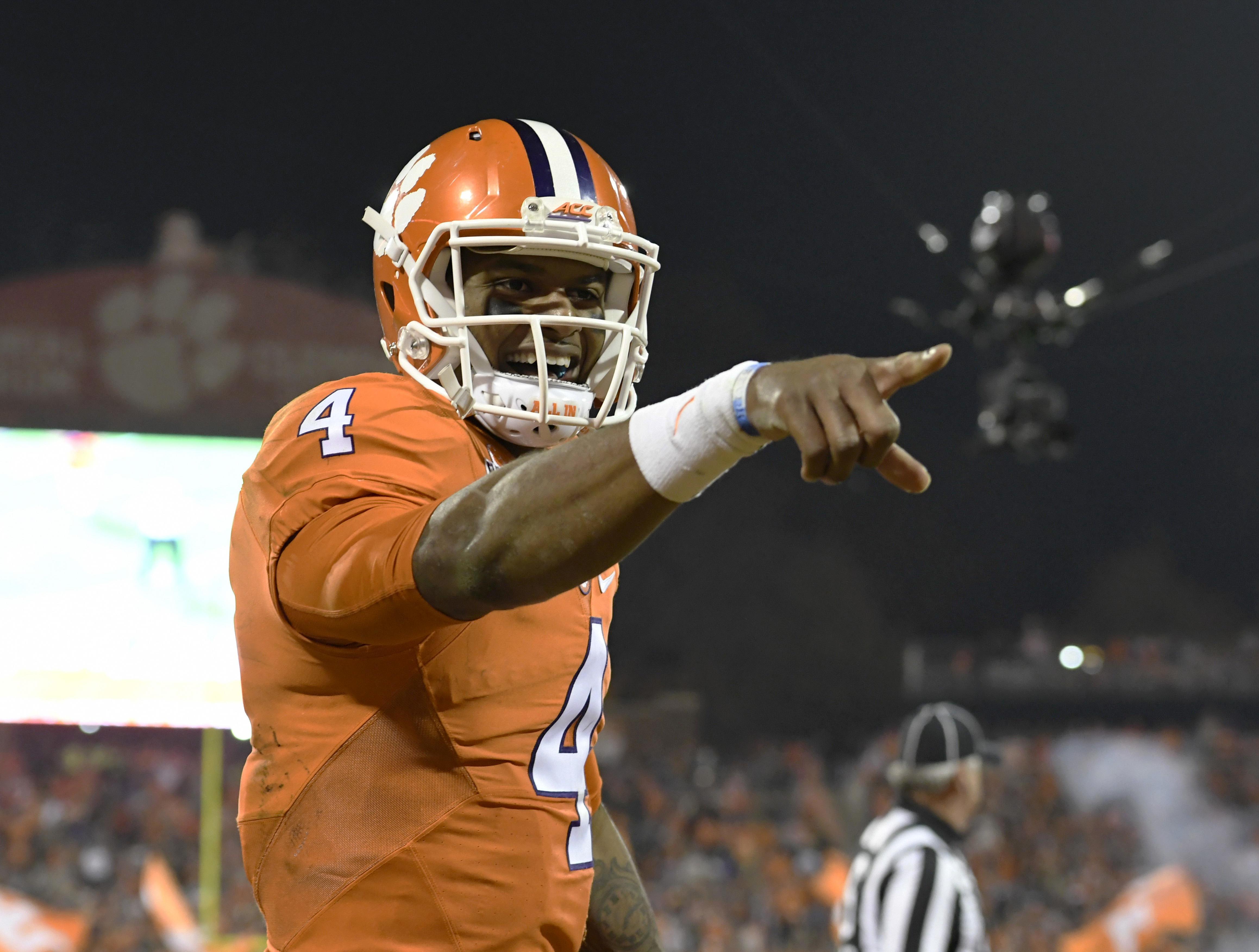 Clemson quarterback Deshaun Watson reacts after throwing a touchdown pass to Artavis Scott during the second half of an NCAA college football game against South Carolina Saturday, Nov. 26, 2016, in Clemson, S.C. (AP Photo/Richard Shiro)