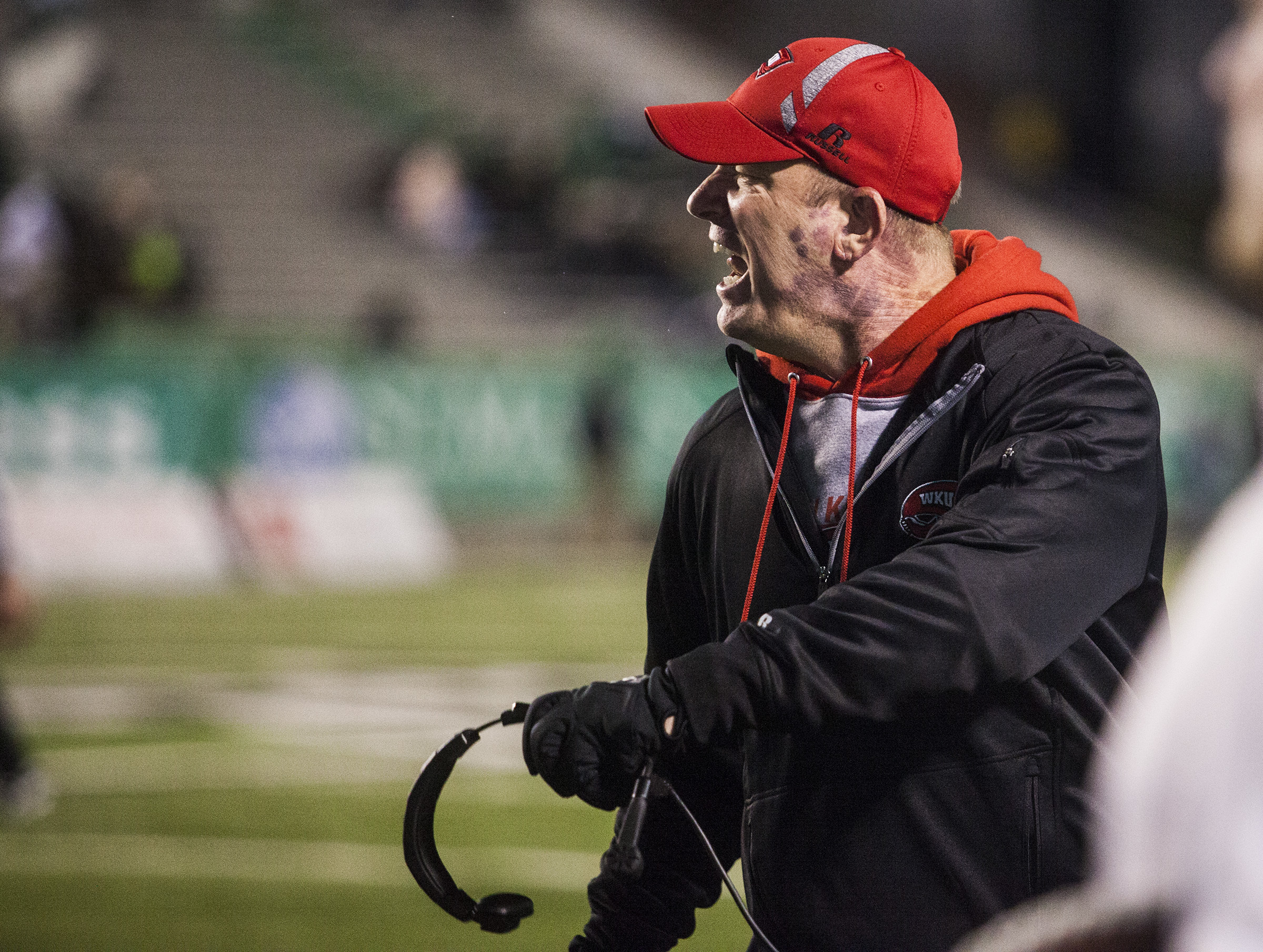 Western Kentucky coach Jeff Brohm shouts at a player during Western Kentucky's 60-6 win over Marshall in an NCAA college football game Saturday, Nov. 26, 2016, in Huntington, W.Va. (Austin Anthony/Daily News via AP)