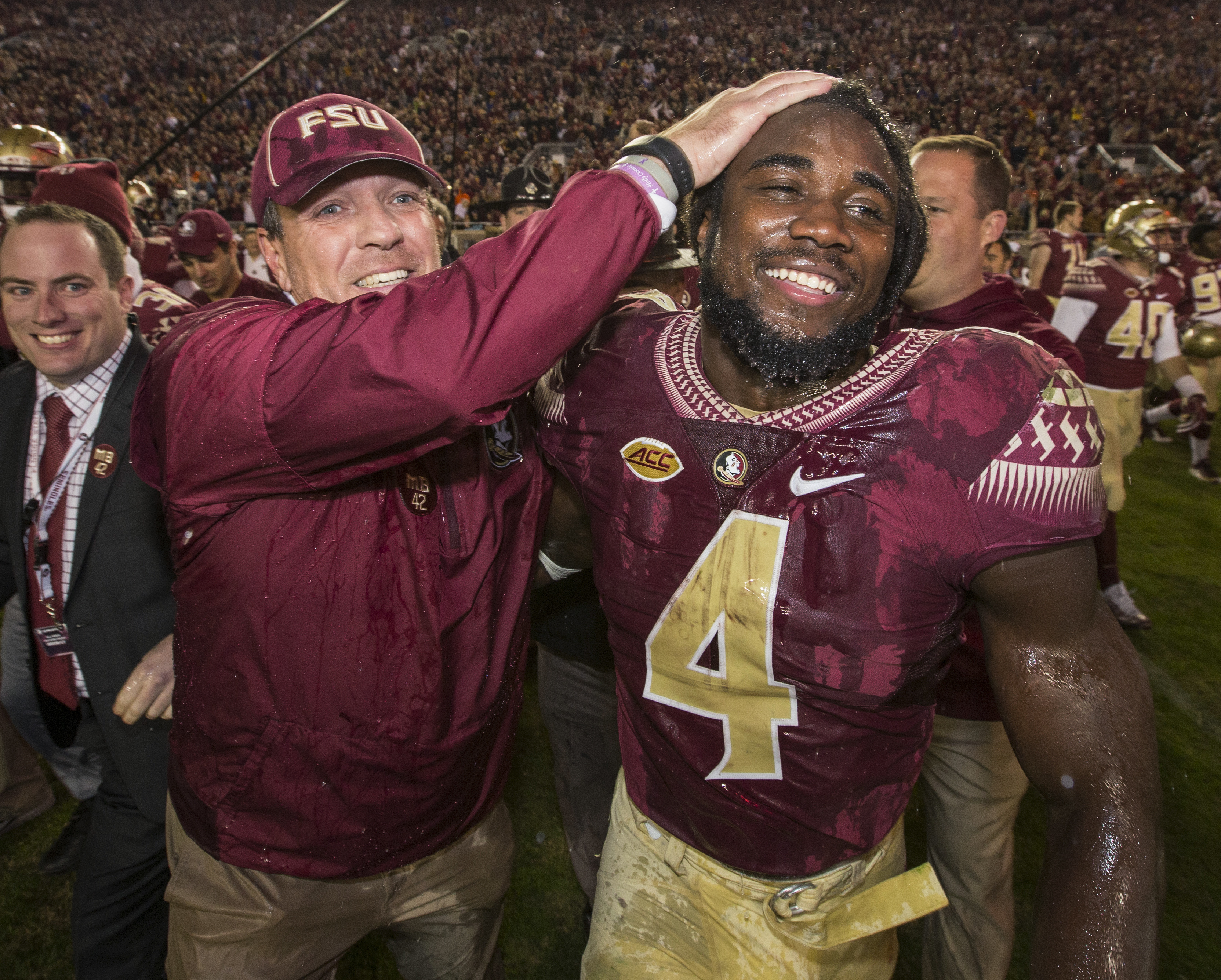 Florida State coach Jimbo Fisher and running back Dalvin Cook celebrate the team's 31-13 win over Florida in an NCAA college football game in Tallahassee, Fla., Saturday, Nov. 26, 2016. (AP Photo/Mark Wallheiser)