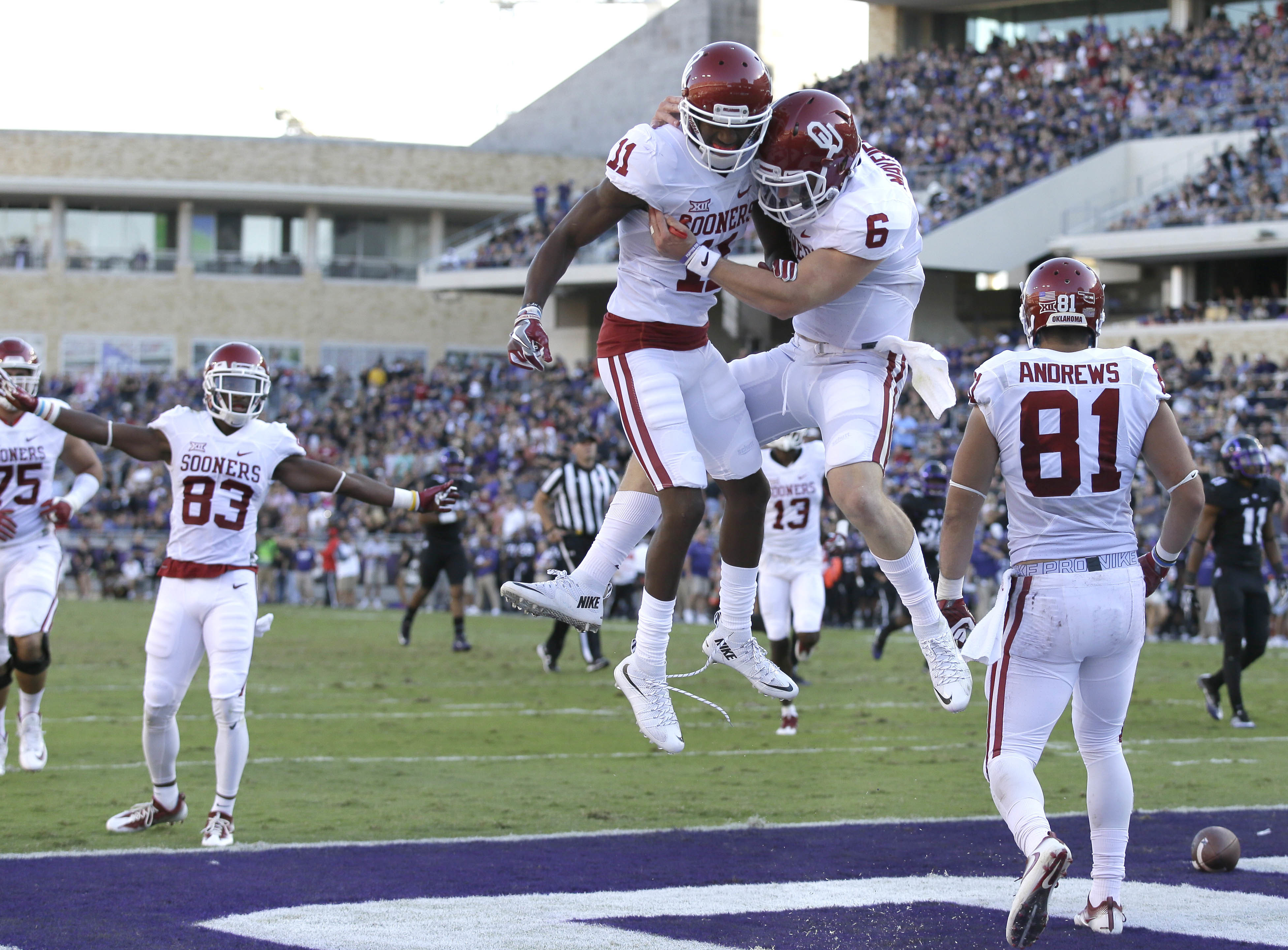 FILE - In this Oct. 1, 2016, file photo, Oklahoma wide receiver Dede Westbrook (11) celebrates catching a touchdown pass with quarterback Baker Mayfield (6) as wide receiver Mark Andrews (81) looks on during the first half of an NCAA college football game