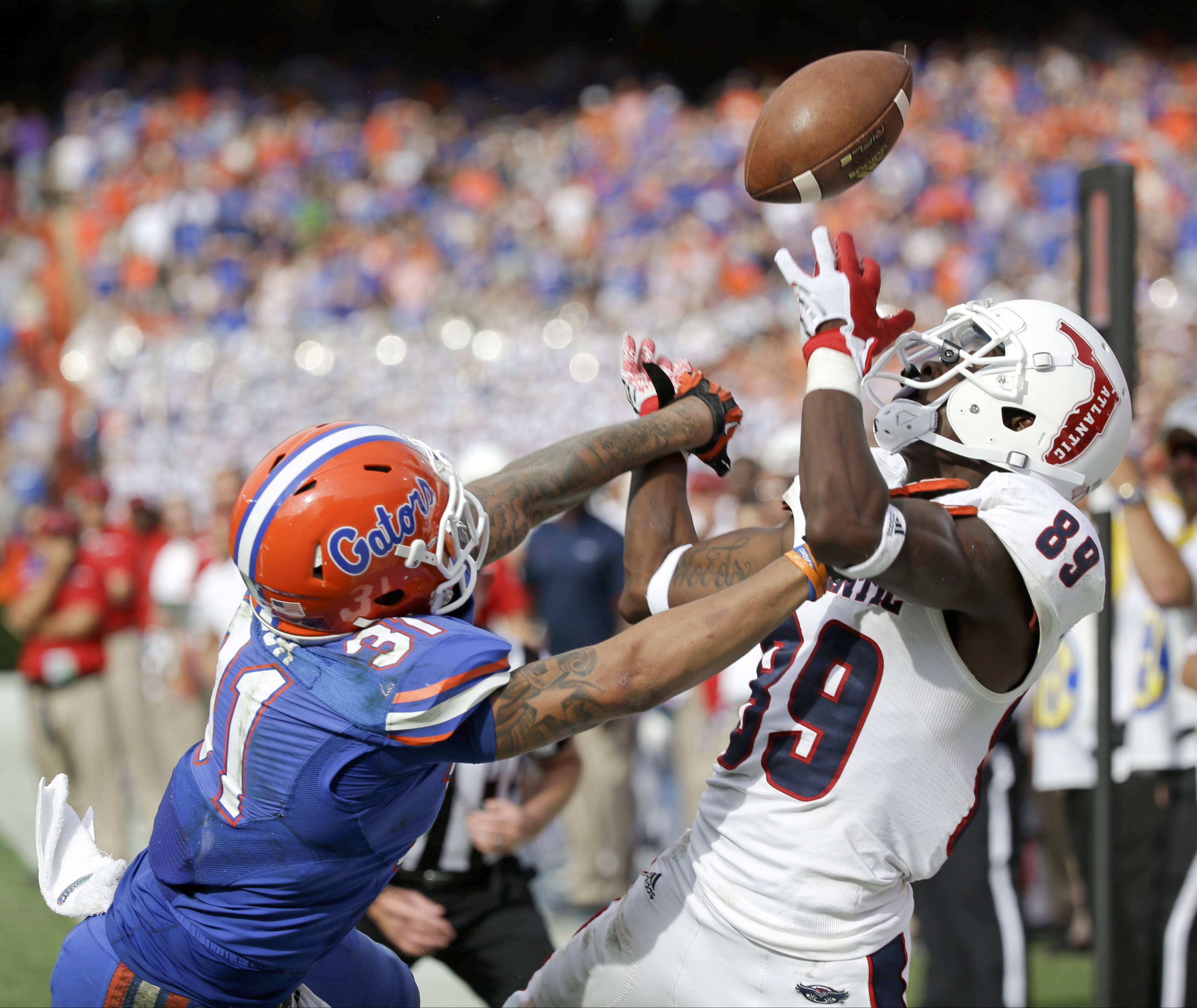 FILE - In this Nov. 21, 2015, file photo, Florida defensive back Jalen Tabor (31) breaks up a pass intended for Florida Atlantic wide receiver Darius James (89) during the second half of an NCAA college football game, in Gainesville, Fla. The Southeastern