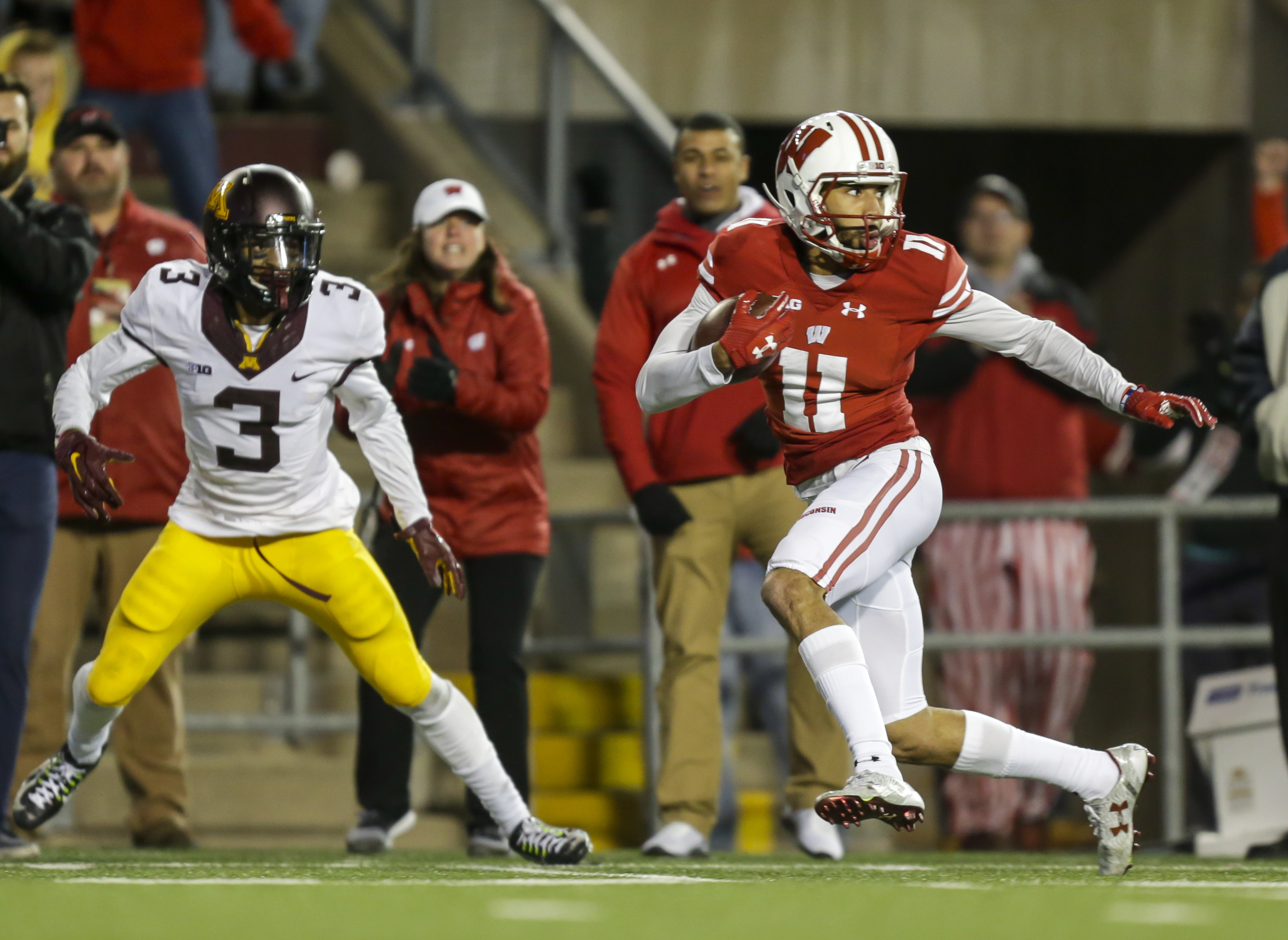 FILE - In this Nov. 26, 2016, file photo, Wisconsin wide receiver Jazz Peavy (11) runs against Minnesota defensive back KiAnte Hardin during the second half of an NCAA college football game, in Madison, Wis. No. 6 Wisconsin dusted off the jet sweep to rou