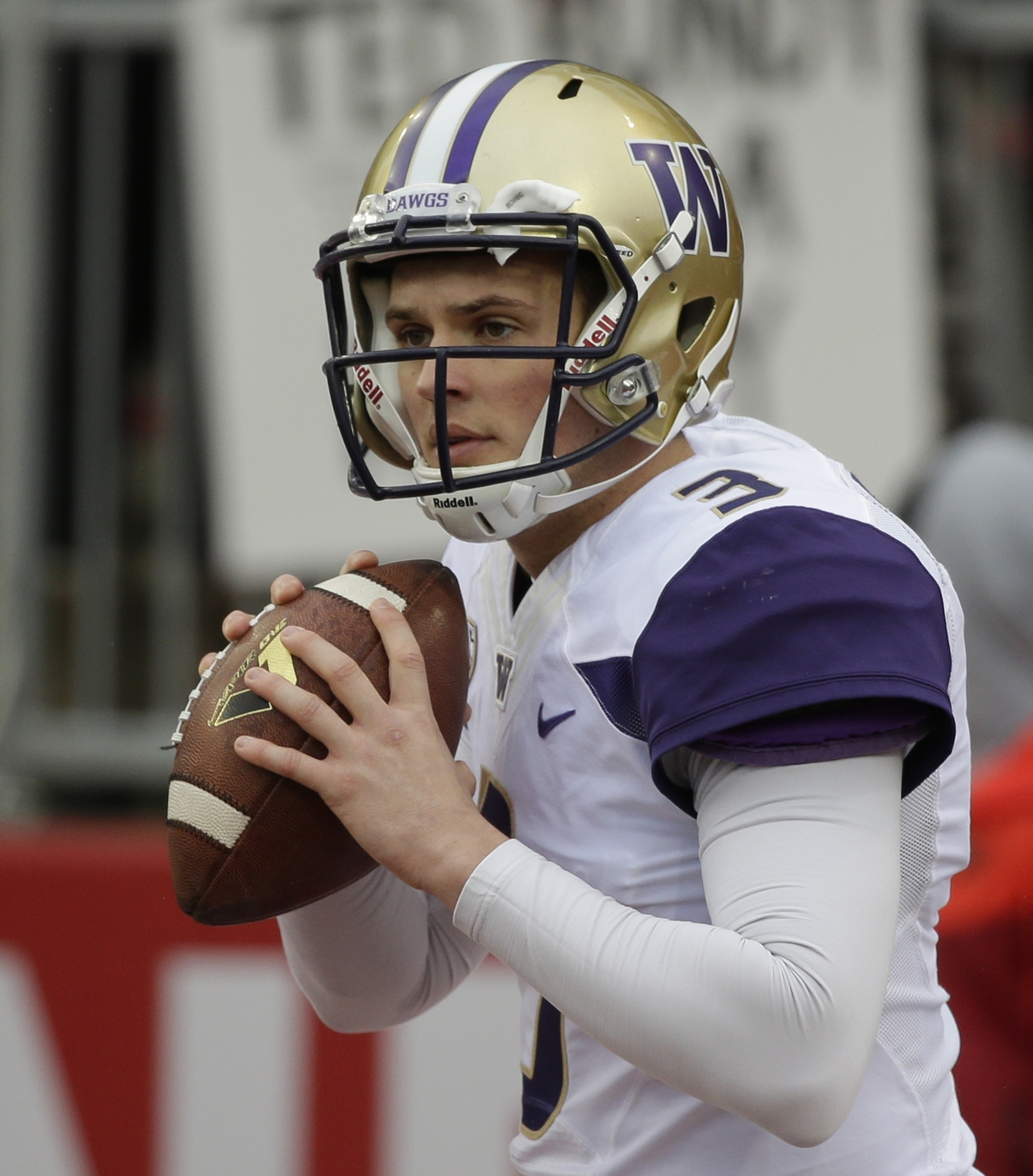 FILE - In this Nov. 25, 2016, file photo, Washington quarterback Jake Browning warms up before an NCAA college football game against Washington State, in Pullman, Wash. The fourth-ranked Huskies take on Colorado in the Pac-12 championship on Friday night