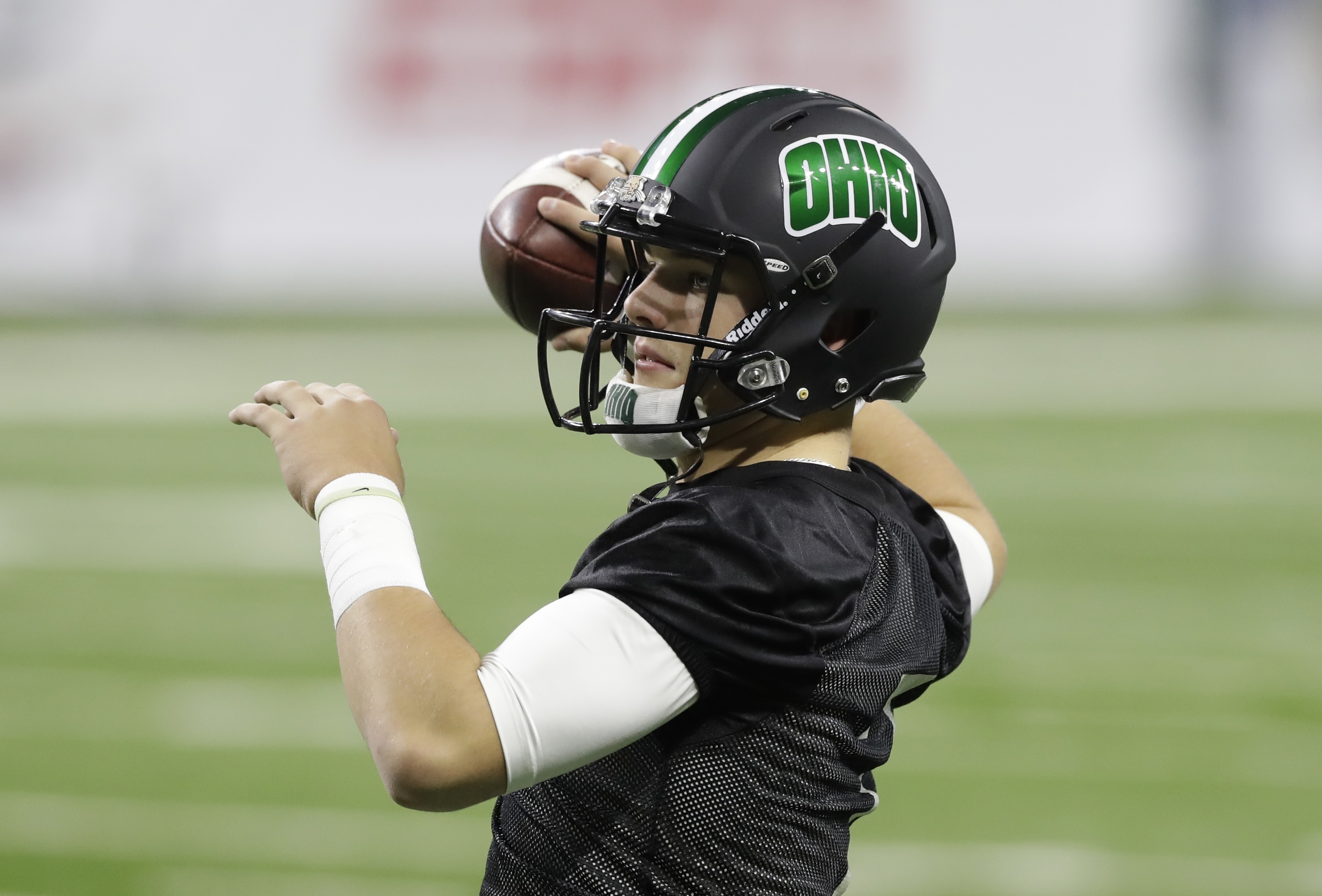 Ohio quarterback Quinton Maxwell throws during an NCAA college football walk-through in Detroit, Thursday, Dec. 1, 2016. Ohio will play Western Michigan in the Mid-American Conference Championship at Ford Field on Friday. (AP Photo/Carlos Osorio)