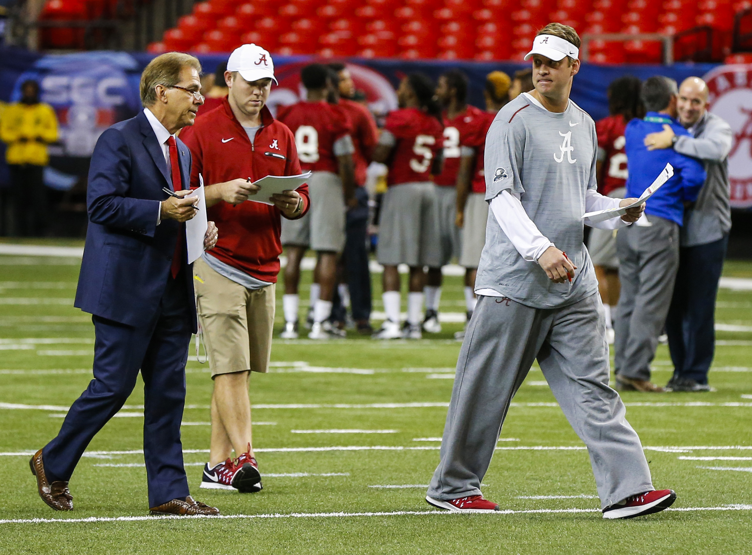 Alabama head coach Nick Saban, left,  talks with Alabama offensive coordinator Lane Kiffin, right, during practice for the Southeastern Conference Championship NCAA college football game where they will play Florida, Friday, Dec. 2, 2016, in Atlanta. (AP