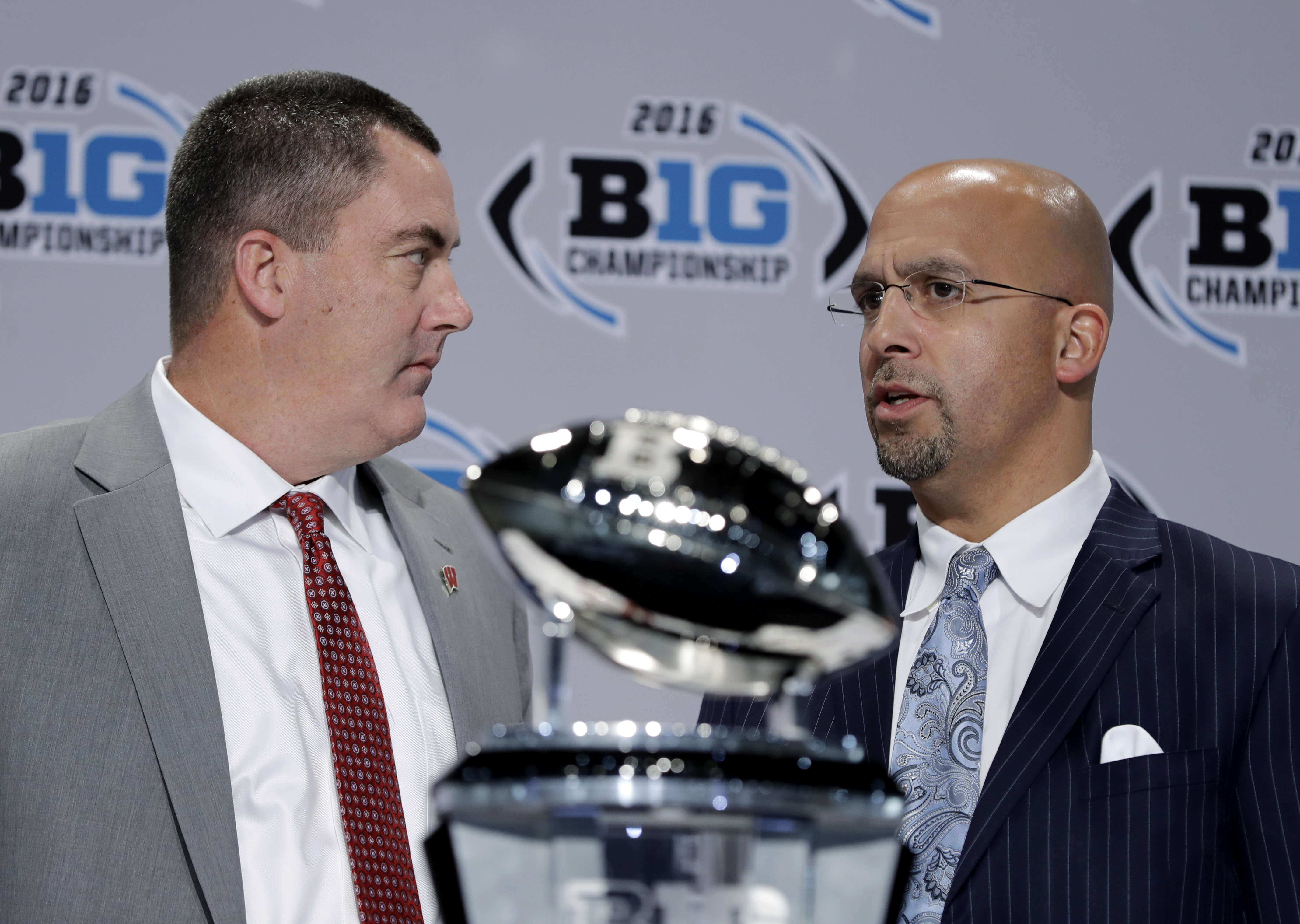 Wisconsin head coach Paul Chryst talks with Penn State head coach James Franklin during a news conference for the Big Ten Conference championship NCAA college football game Friday, Dec. 2, 2016, in Indianapolis. Wisconsin will play Penn State Saturday for