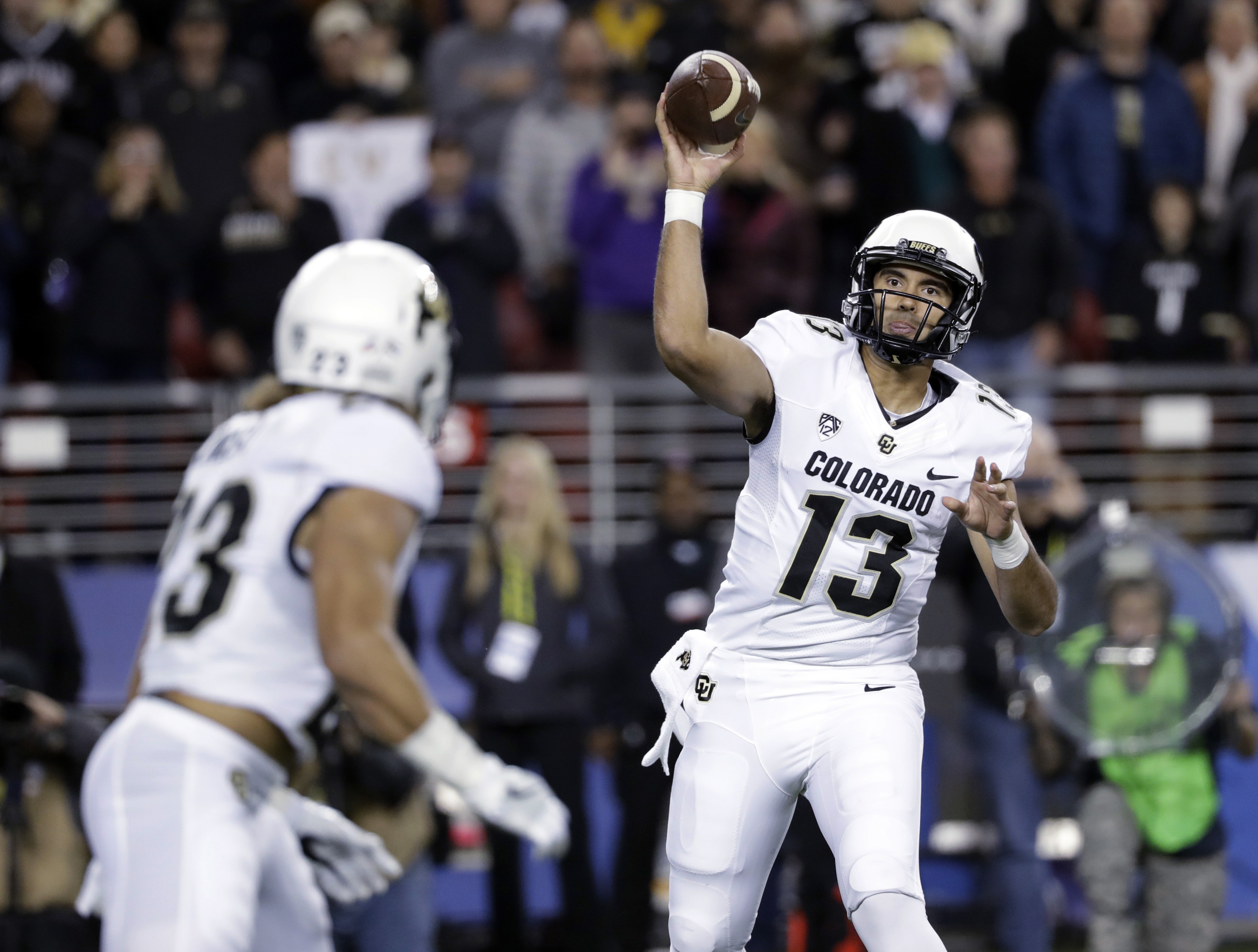 Colorado quarterback Sefo Liufau (13) throws to running back Phillip Lindsay during the first half of the Pac-12 Conference championship NCAA college football game against Colorado on Friday, Dec. 2, 2016, in Santa Clara, Calif. (AP Photo/Marcio Jose Sanc