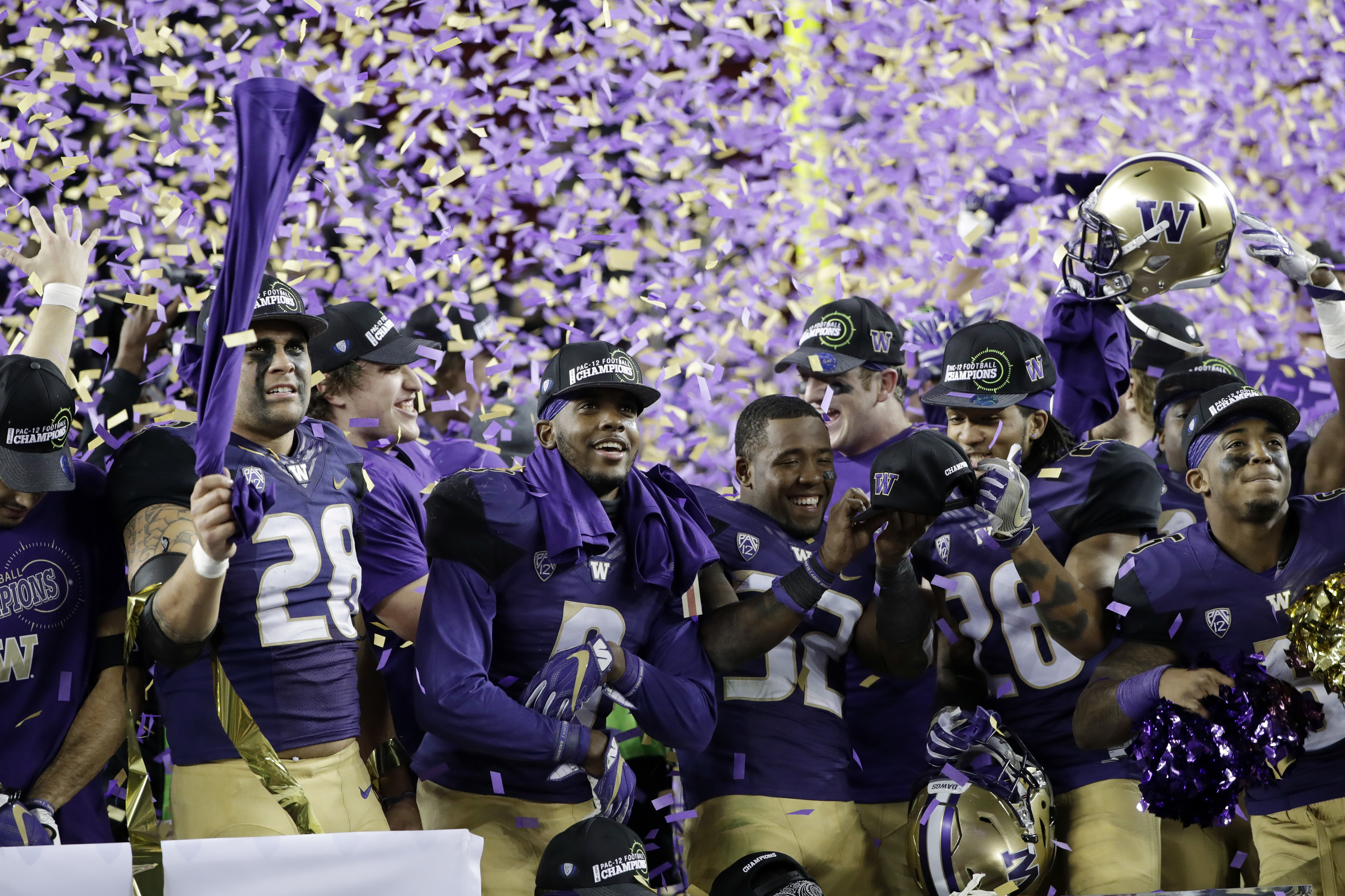 Washington players celebrate the team's 41-10 win over Colorado in the Pac-12 Conference championship NCAA college football game Friday, Dec. 2, 2016, in Santa Clara, Calif. (AP Photo/Marcio Jose Sanchez)